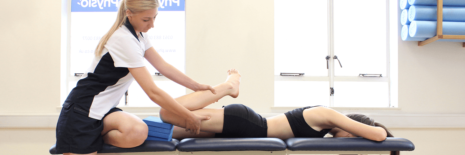 Trained physio.co.uk physiotherapist applies leg massage treatment using props to aid recovery.