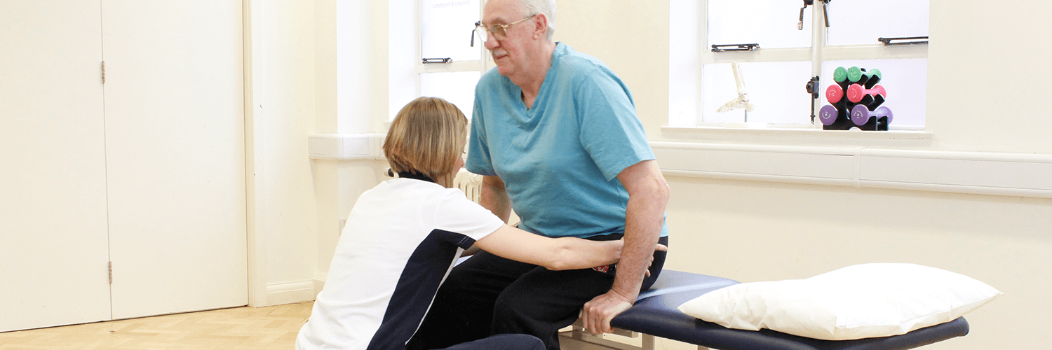 Elderly male recieves Neurological Physiotherapy aid via a trained physio.co.uk physiotherapist.