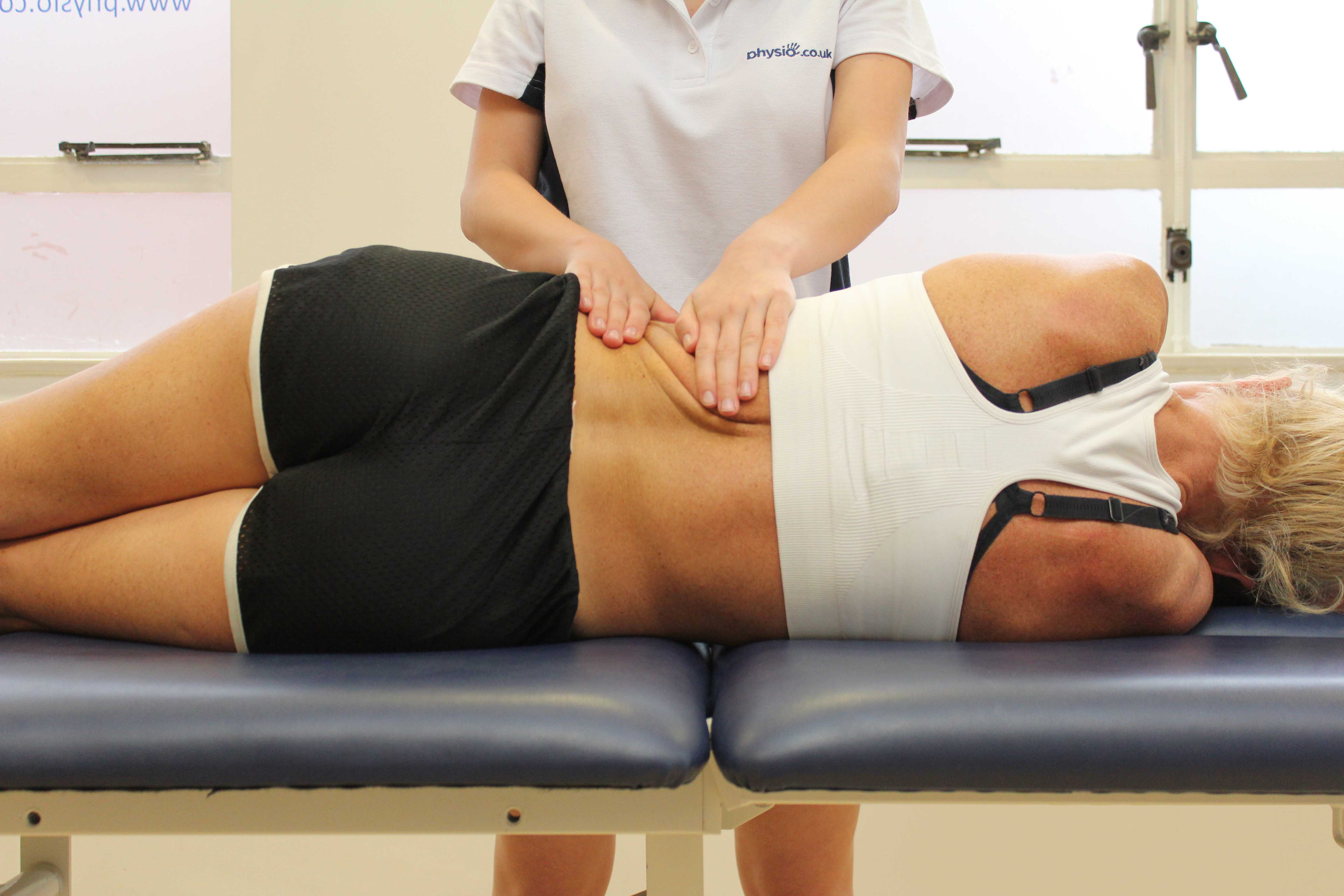 Soft tissue massage of oblique abdominal muscles