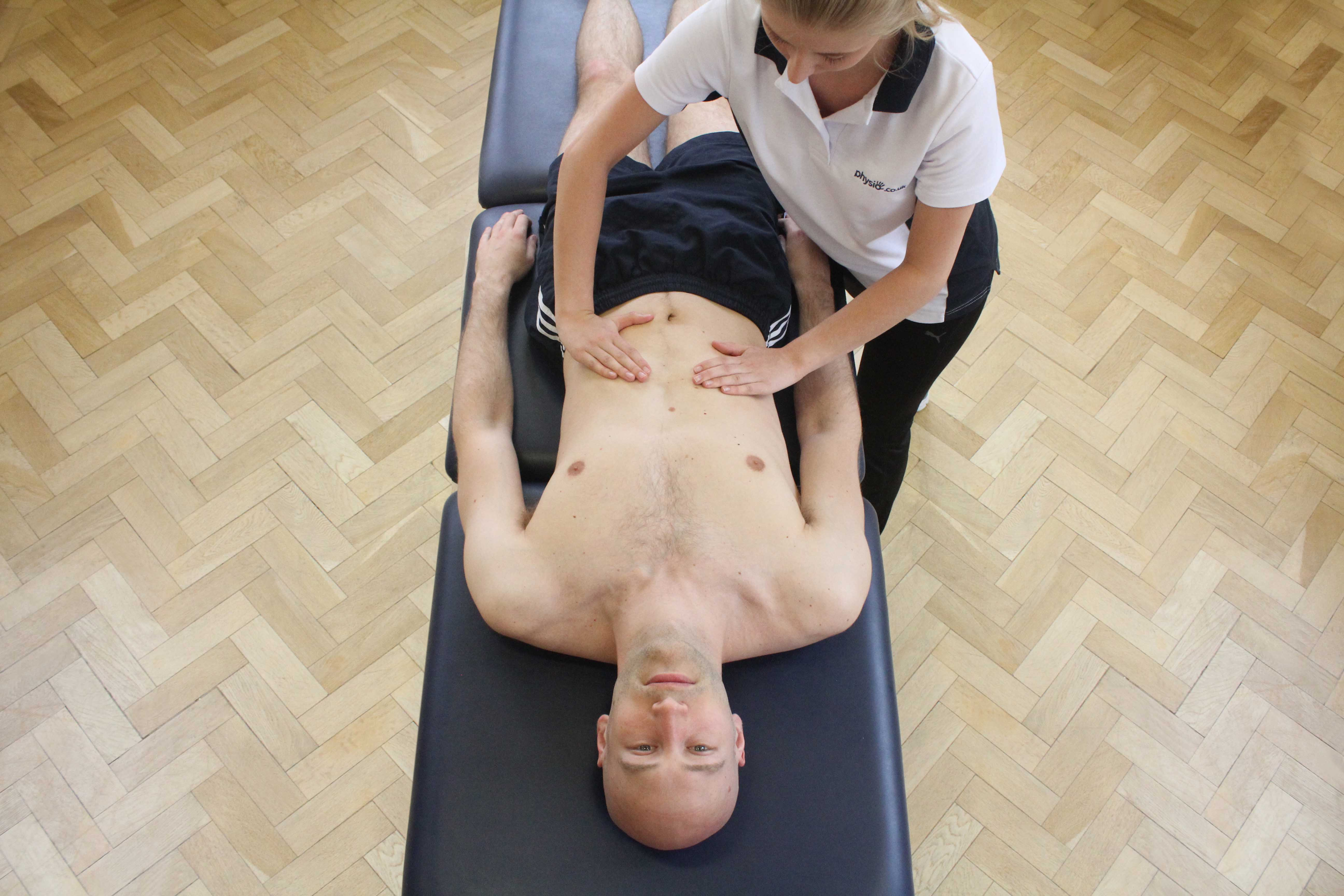 Soft tissue massage of rectus abdominis muscle