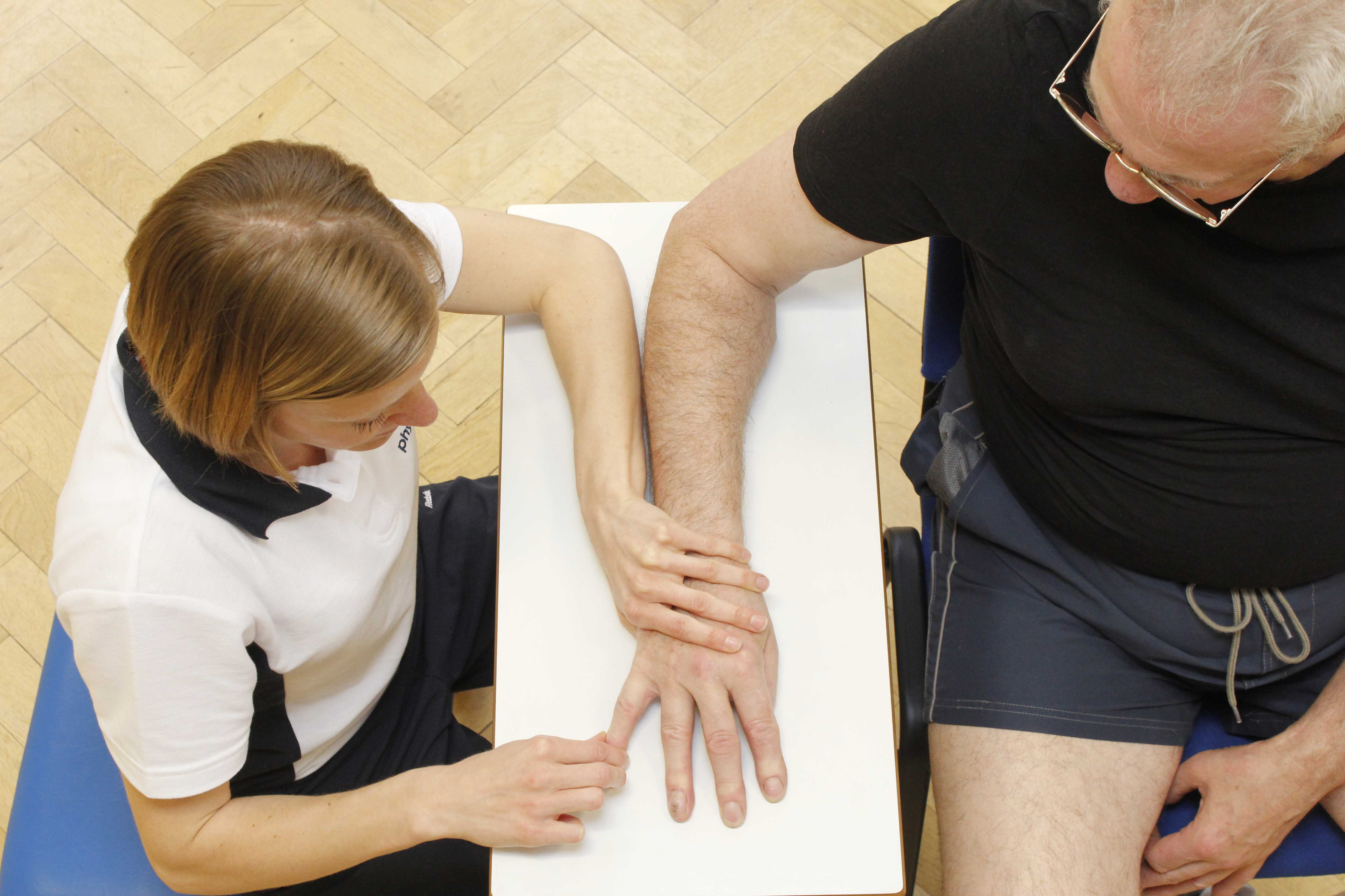 Specilaist neurological physiotherapist using massage and mobilisation to address abnormal sensation
