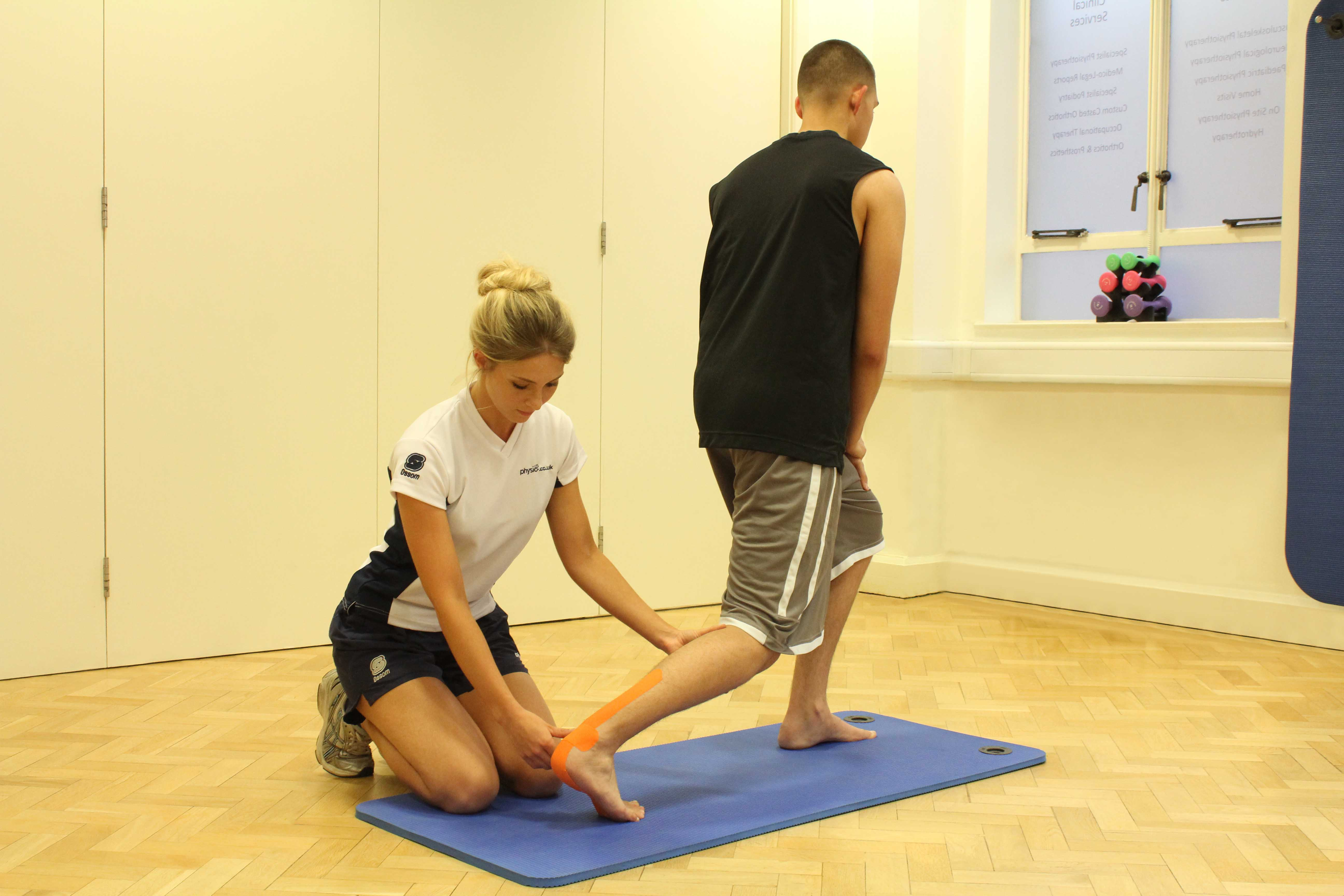 Taping the ankle to improve stability during rehabilitation exercises
