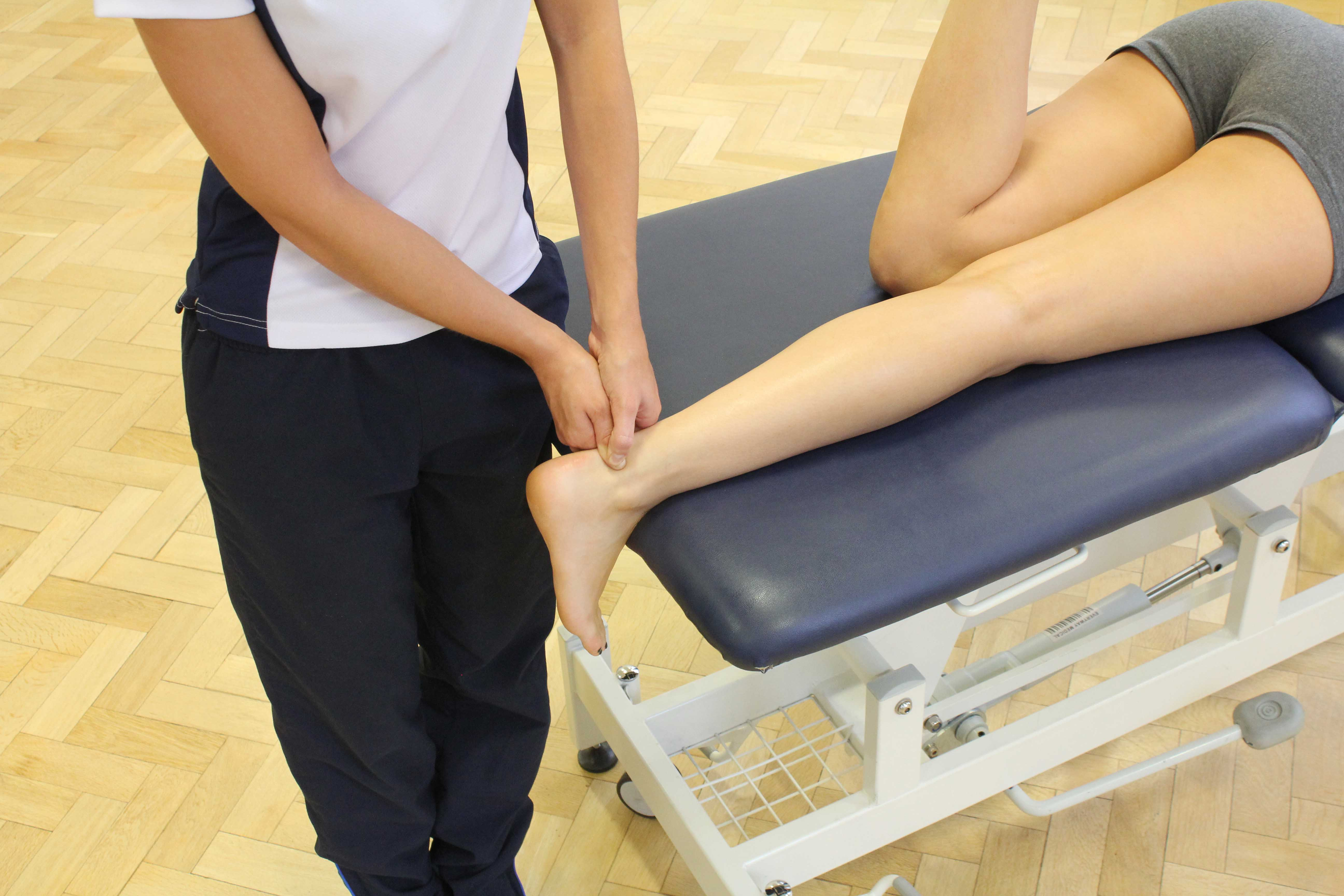 Friction massage applied to the achilles tendon by specialist therapist