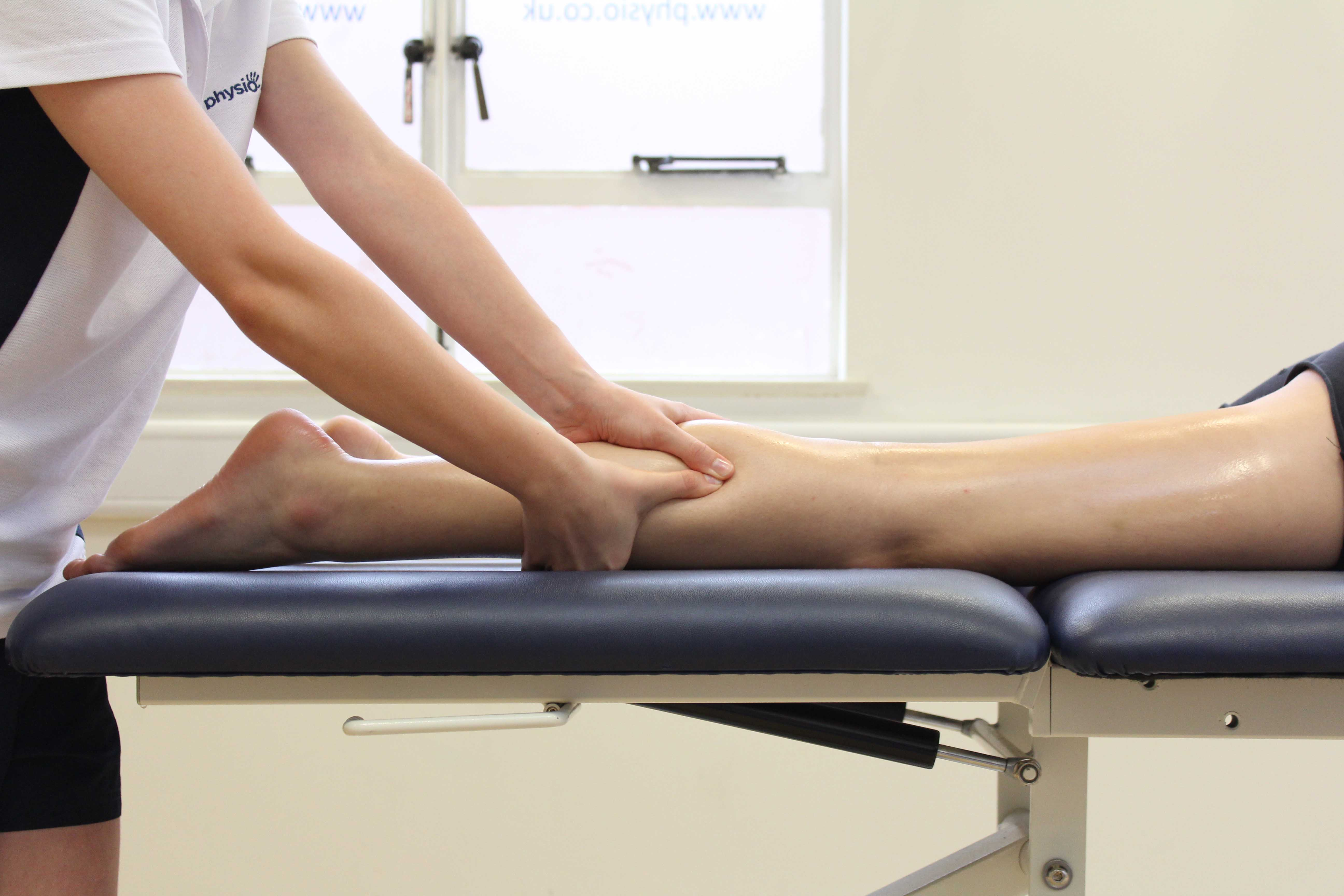 Accupressure massage of the gastroc nemius muscle by physiotherapist