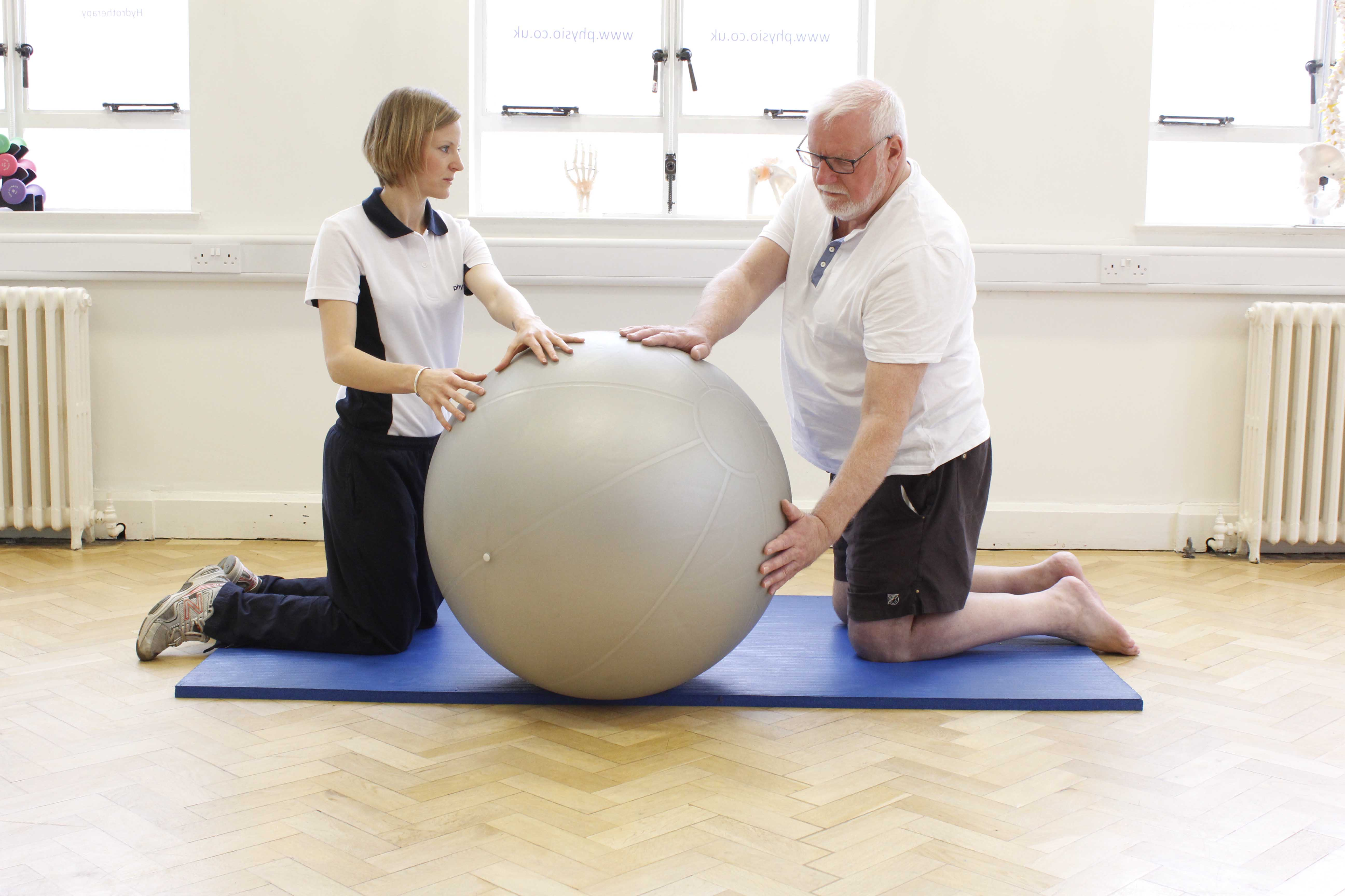 Low impact upper limb and core mobility exercises supervised by a specilaist physiotherapist