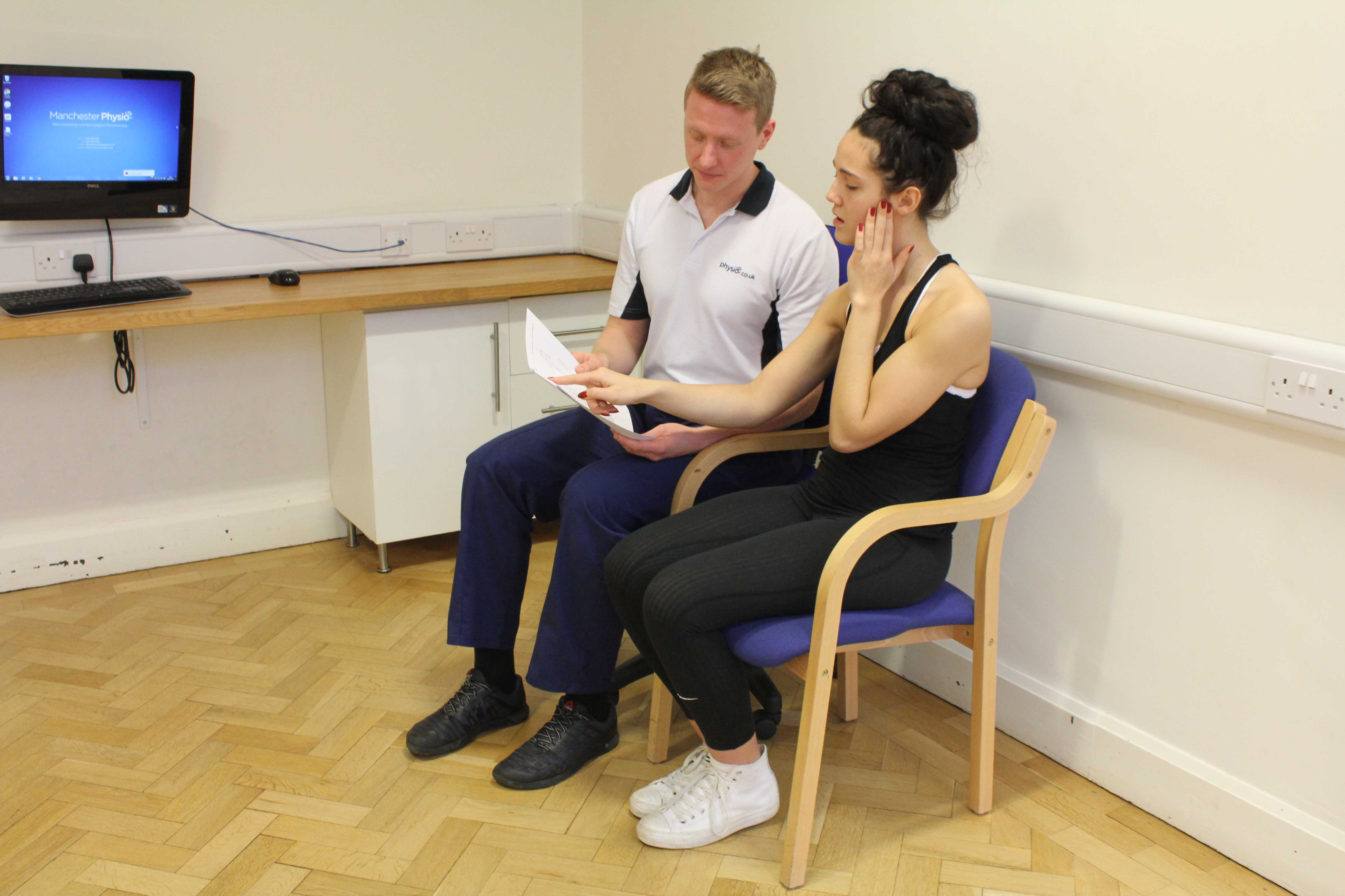 Experienced physiotherapist supplying advice to the client about their condition