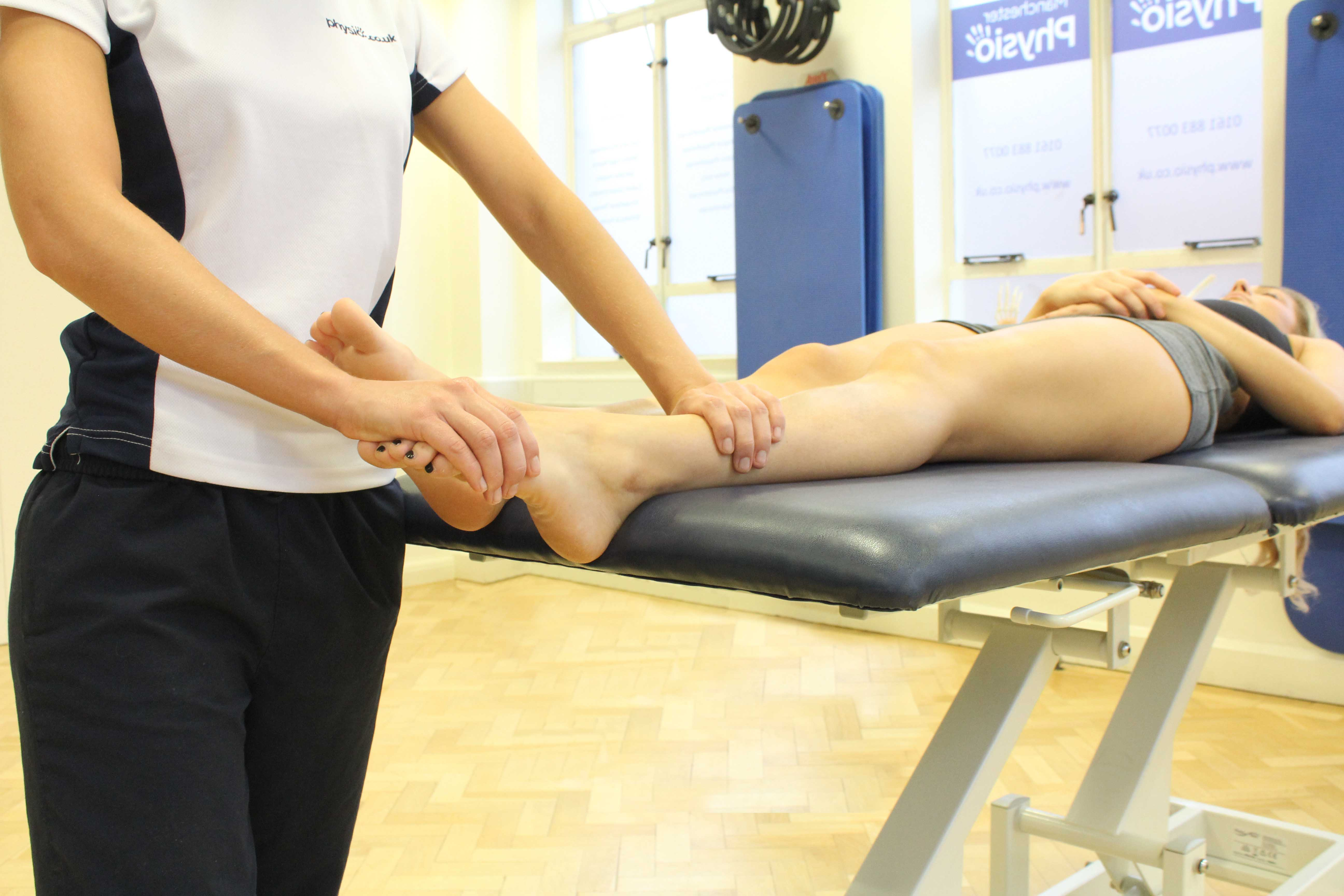Passive stretch of the connective tissues in the foot and ankle by experienced therapist