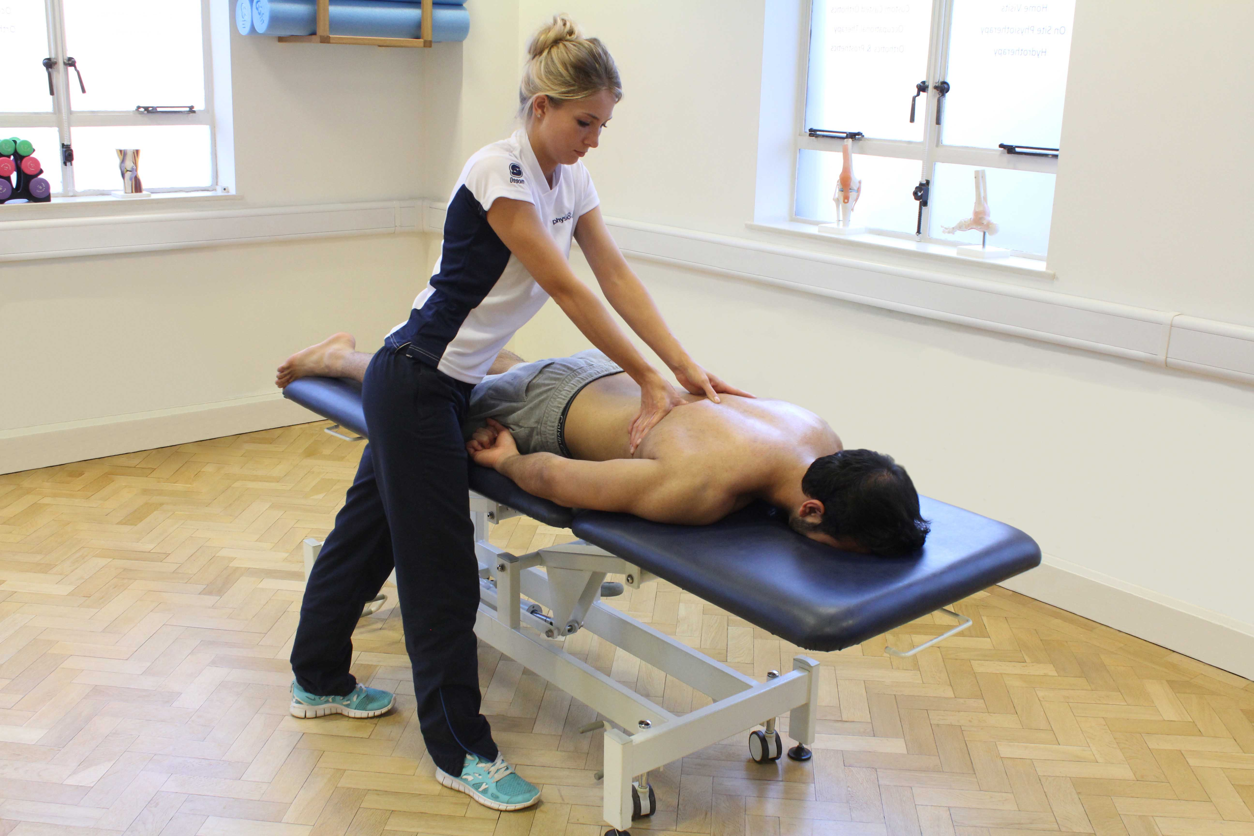 Trigger point massage of the thoracic vertebrea to relieve pain and stiffness