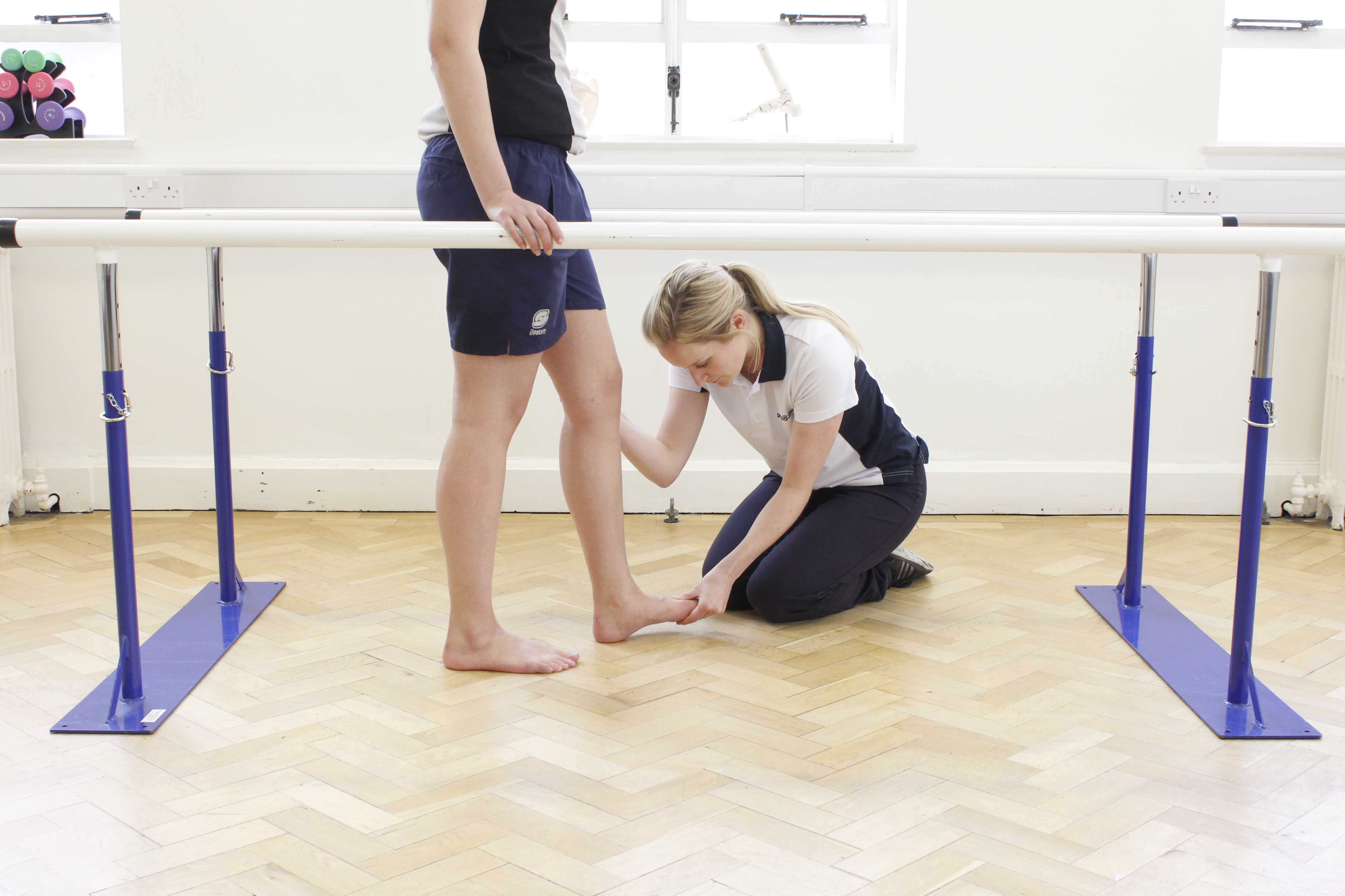 Straight leg raises performed uder the supervision of a apecialist neuological physiotherapist