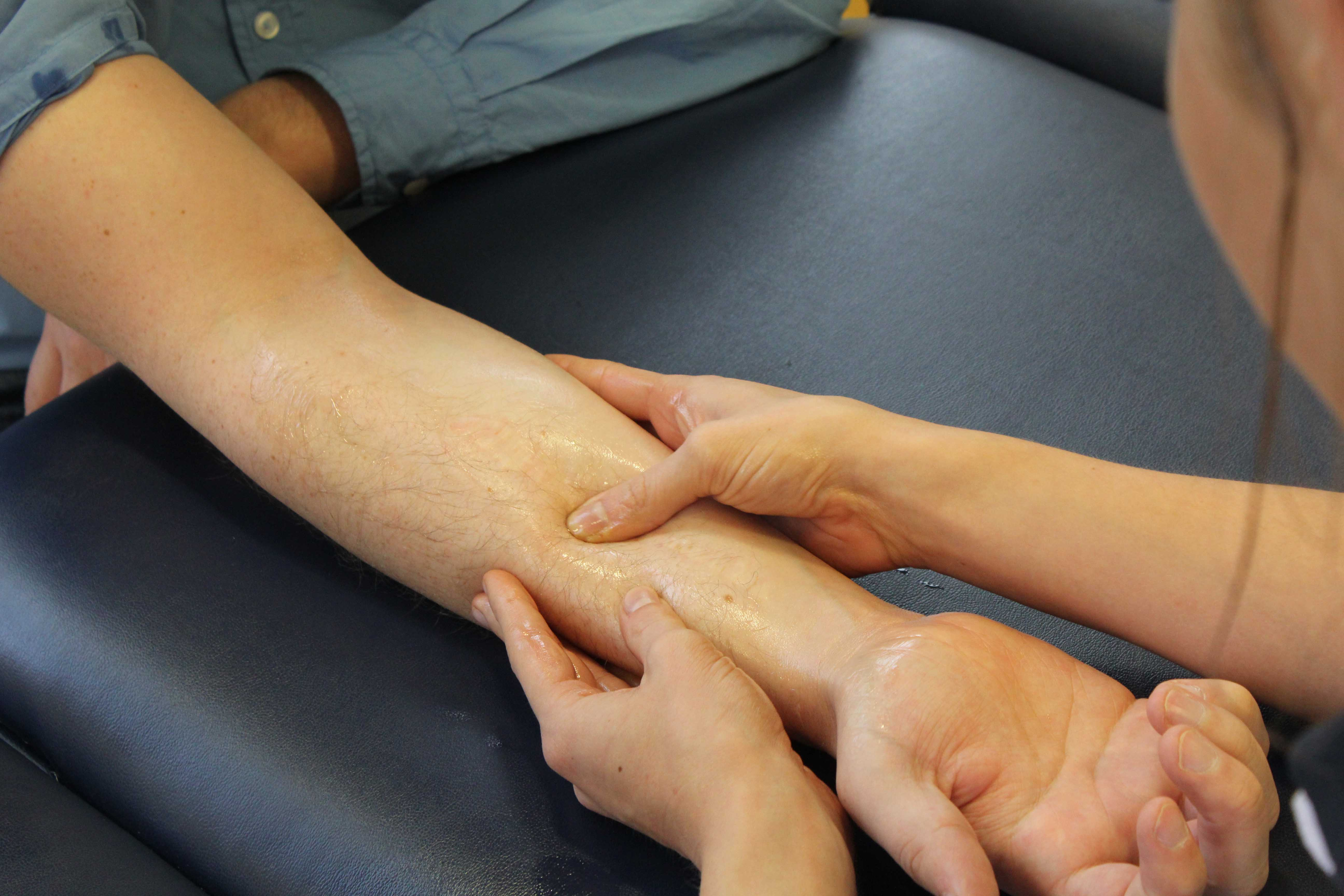 Soft tissue massage of the forearm focusing on flexor muscles