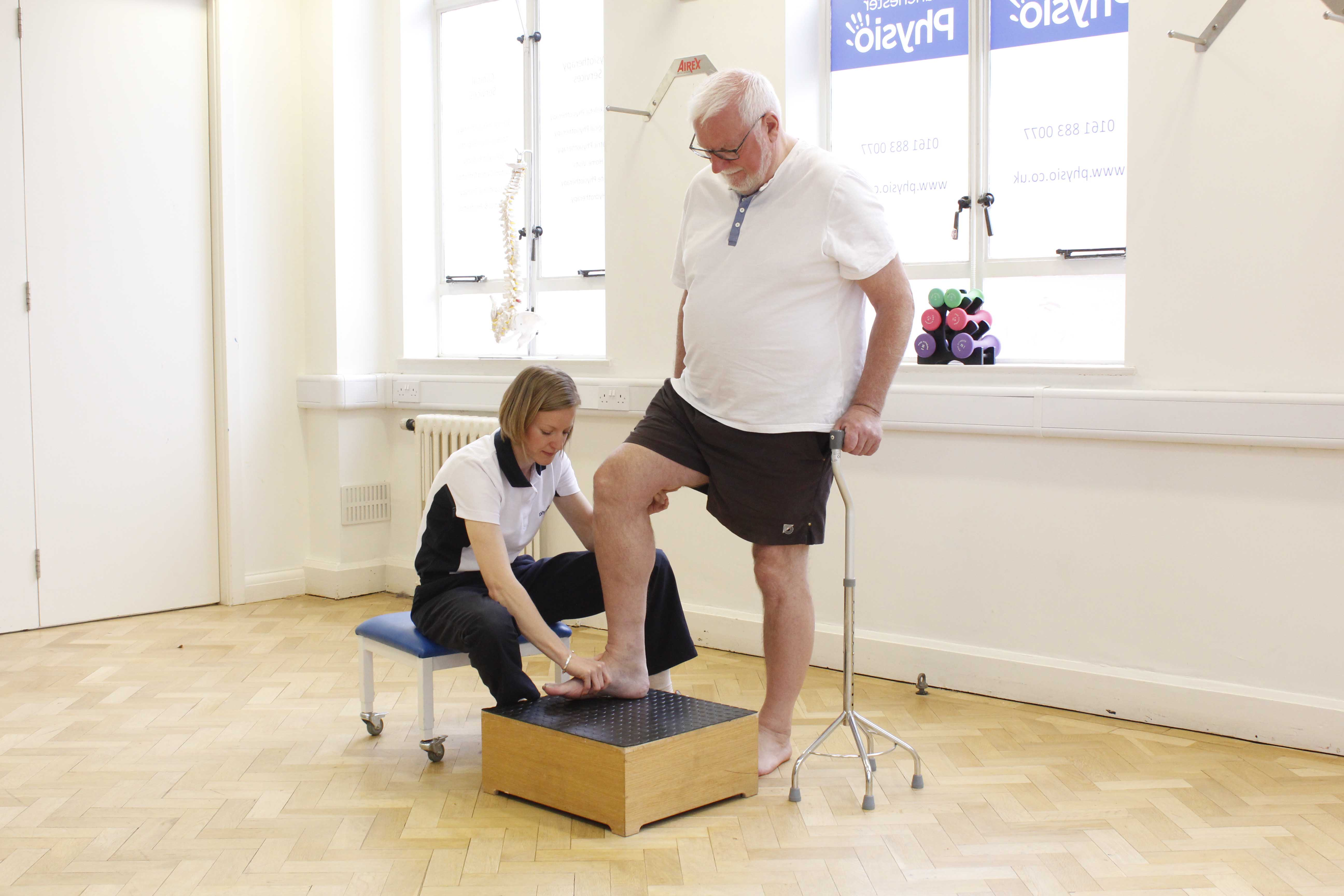 Neurological physiotherapist assisting functional mobility exercises to improve independent living