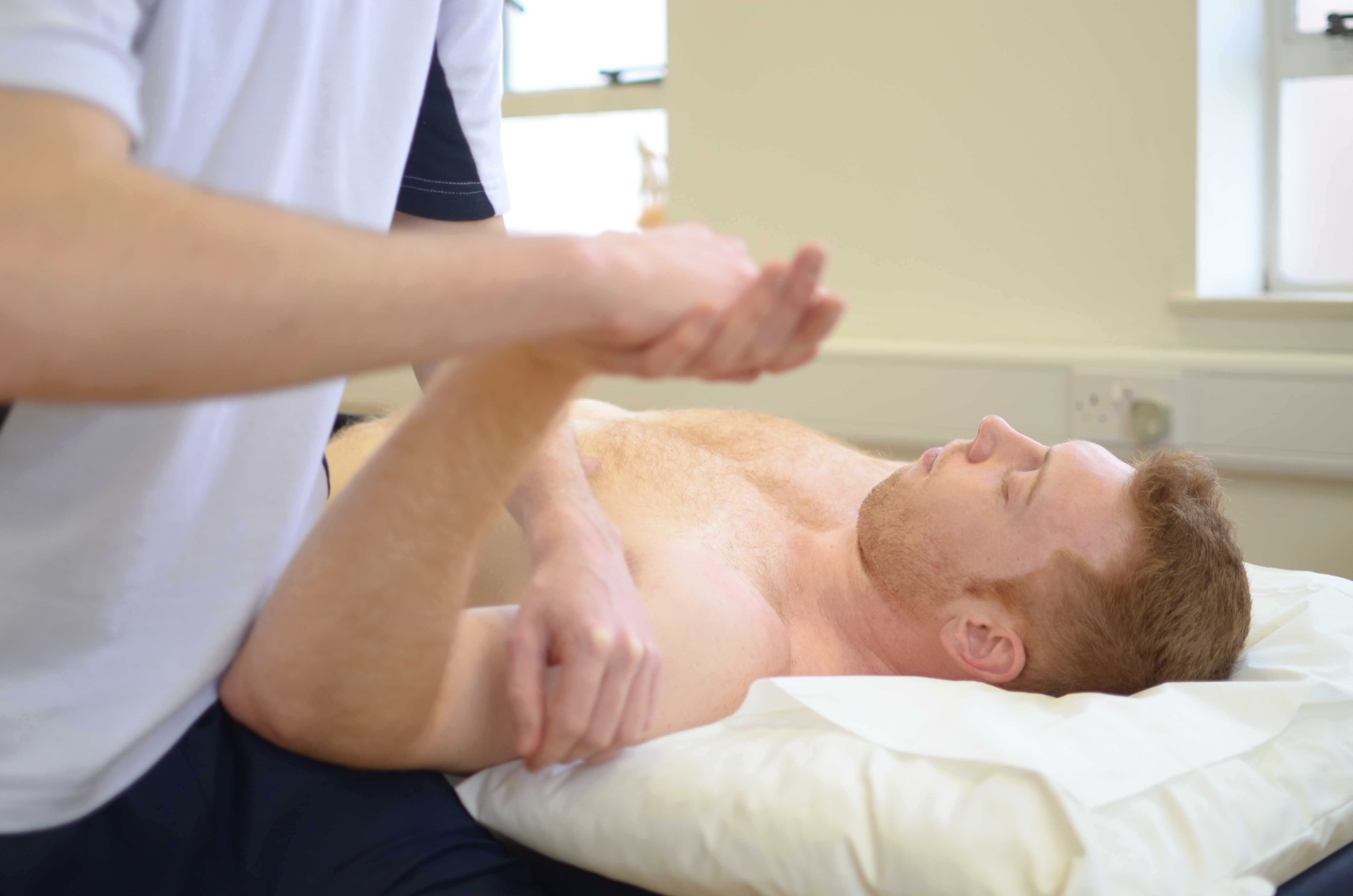 Passive stretches and mobilisations of the elbow by MSK therapist