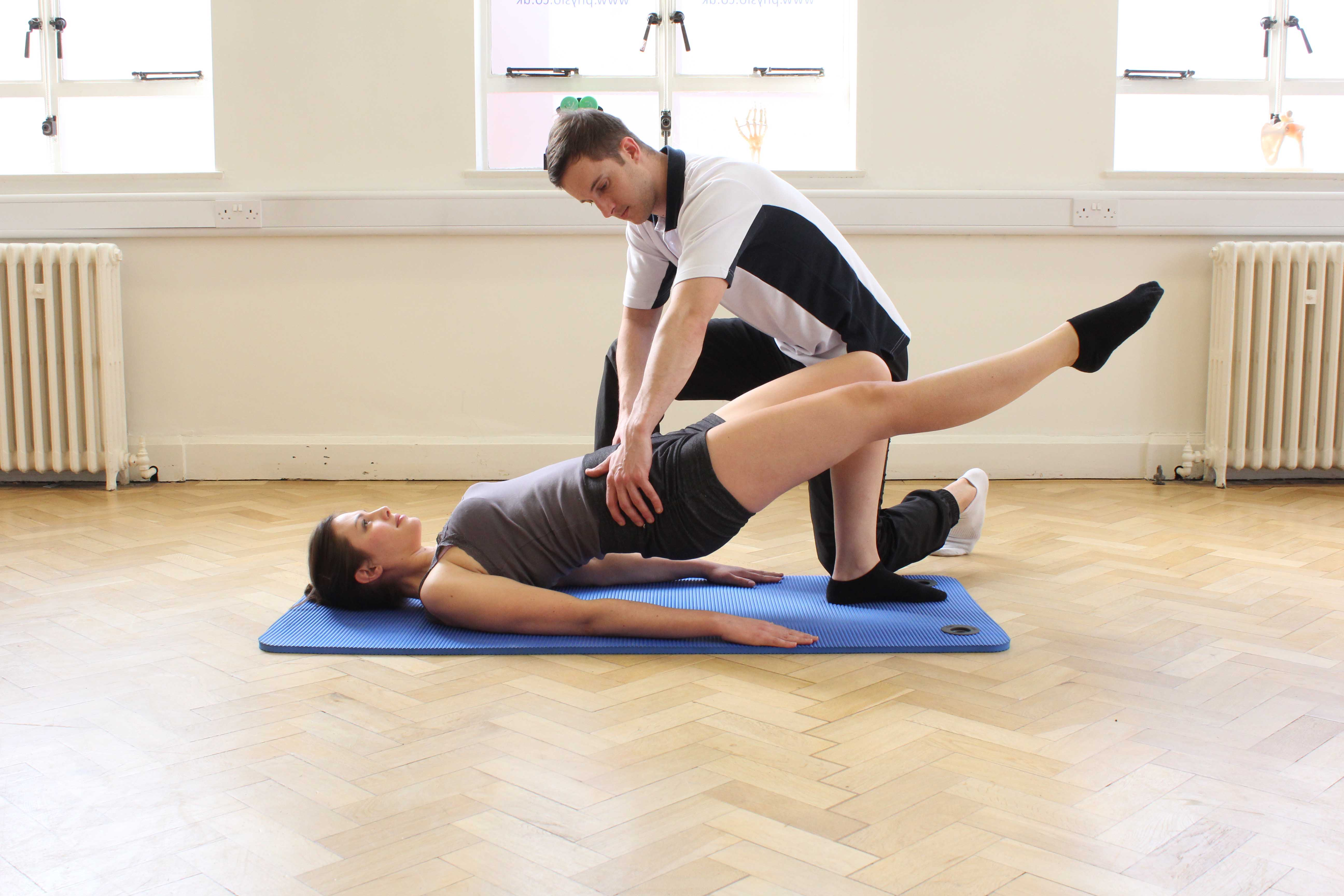 Hip and core stability exercises supervised by an experienced physiotherapist