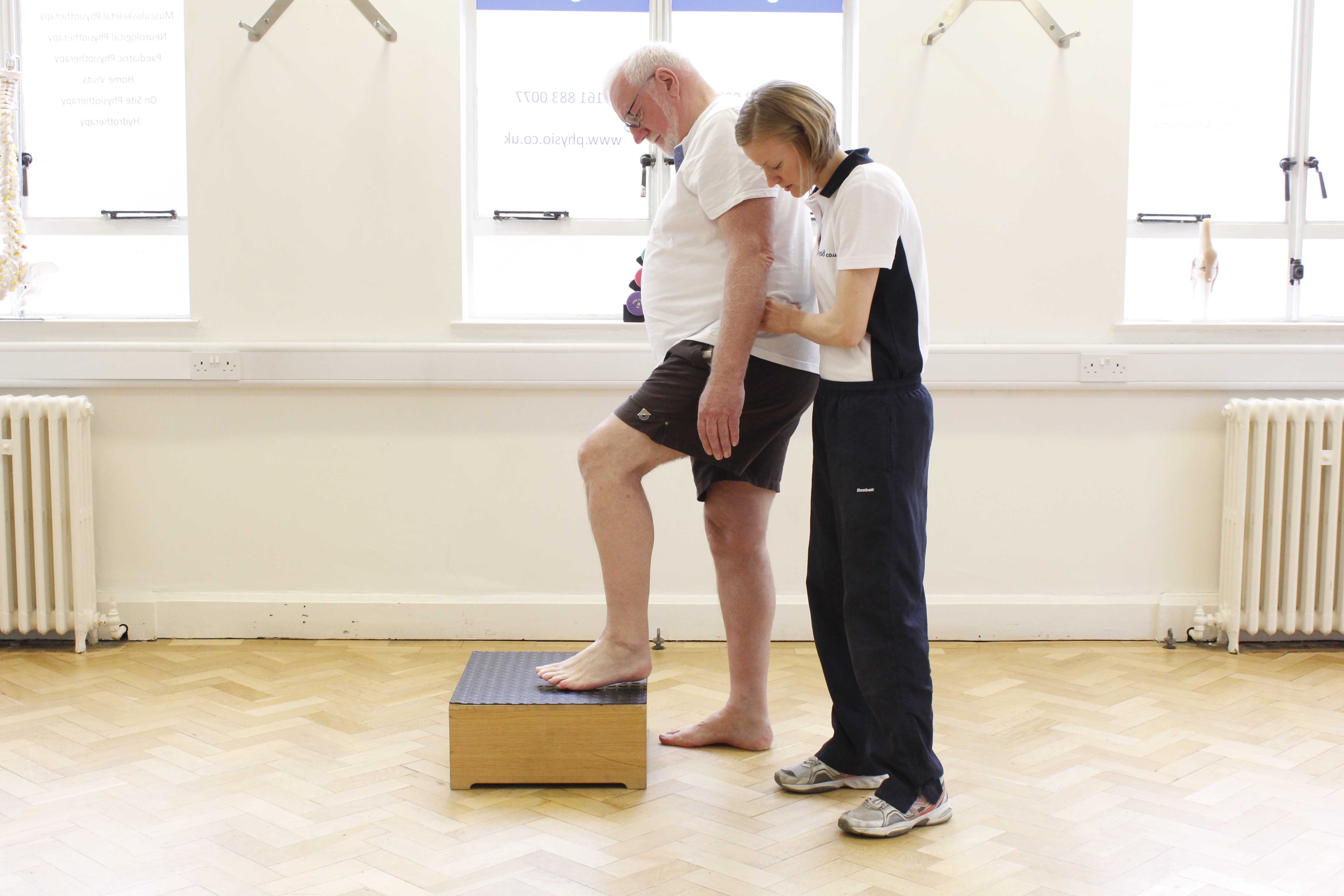 Functional mobility exercises assisted by a specialist neuro physiotherapist
