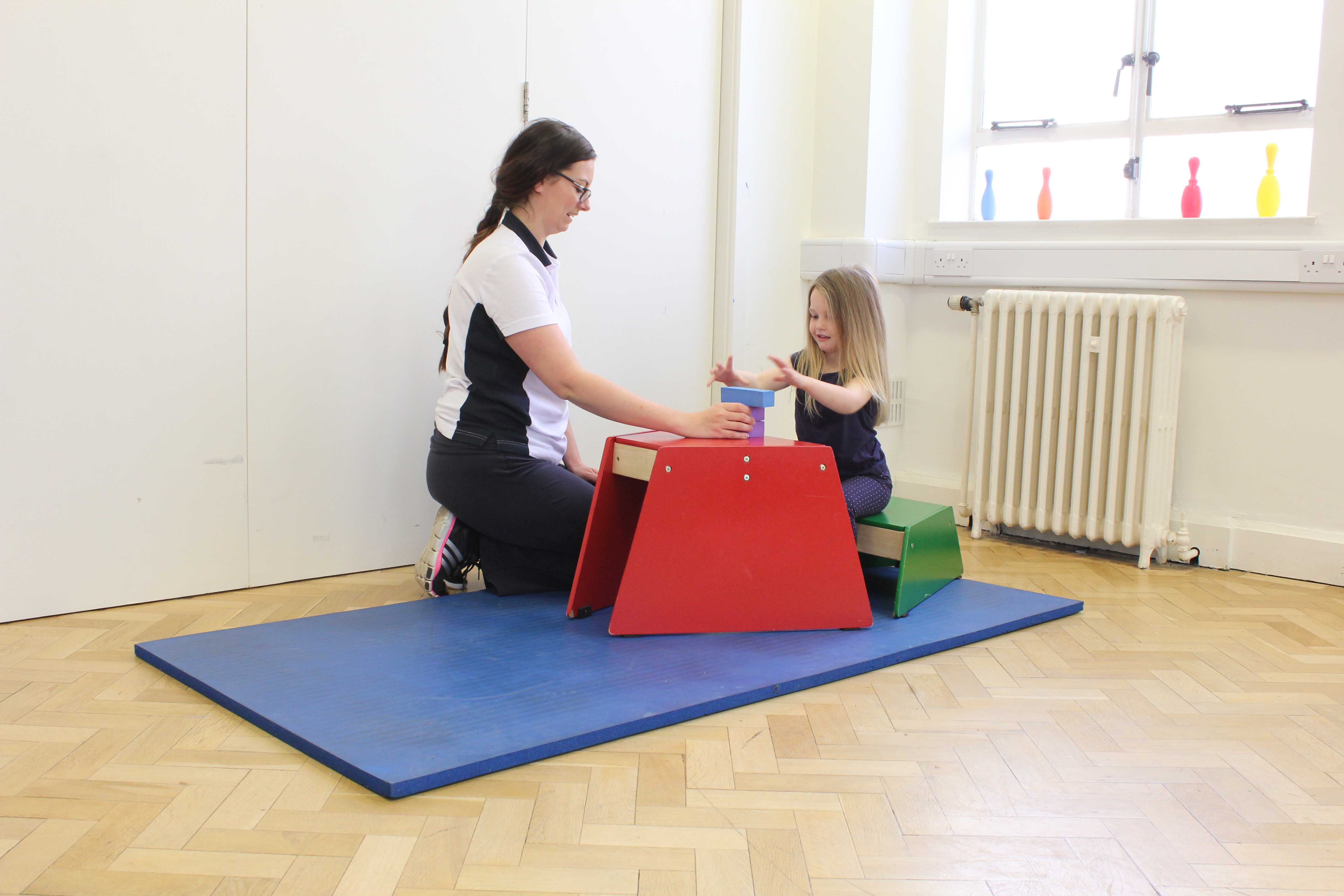 Functional fine motor skill exercises supervised by a neurological paediatric physiotherapist
