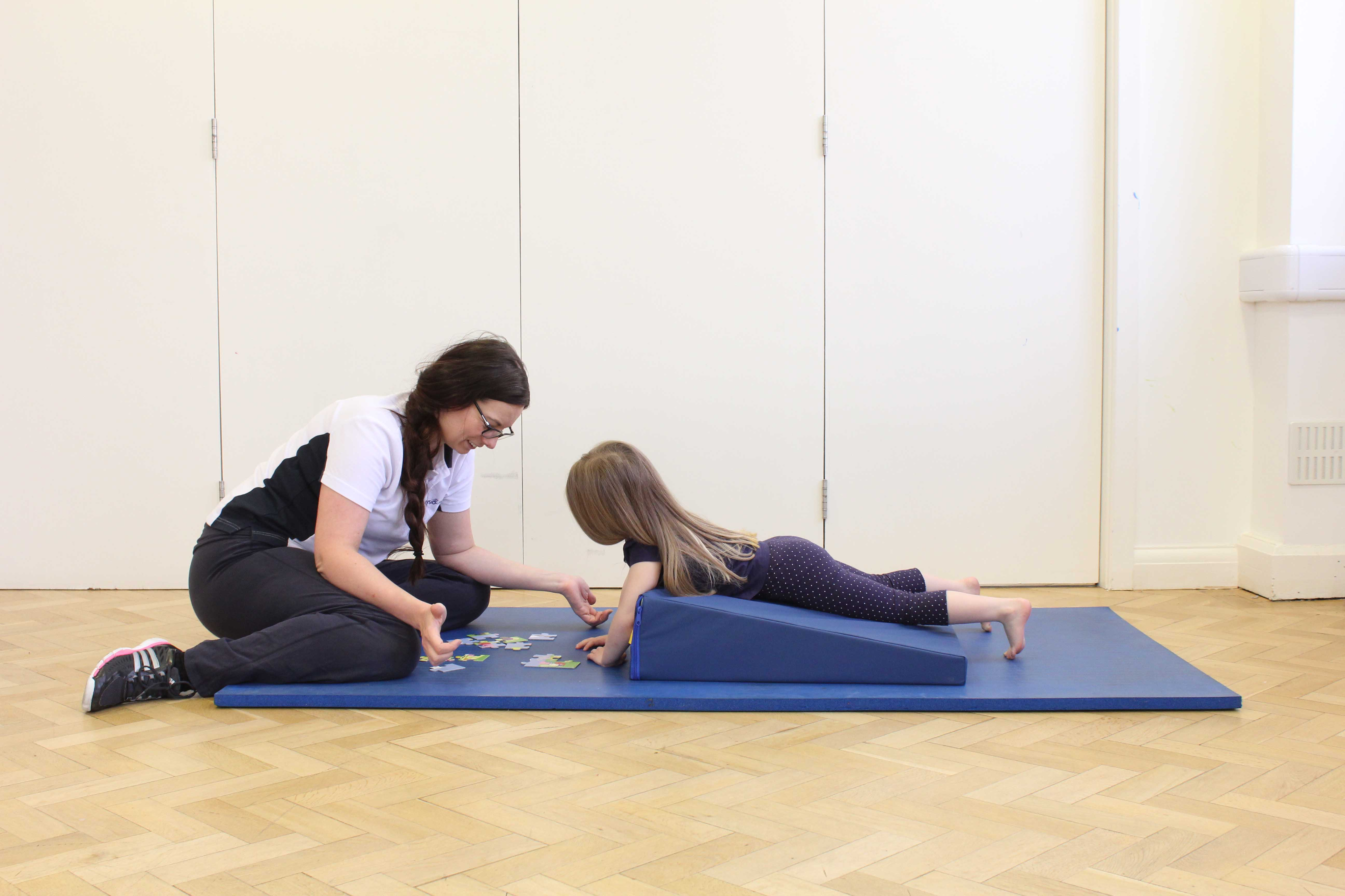 Upper limb mobility exercises through play activities supervised by a neurological physiotherapist