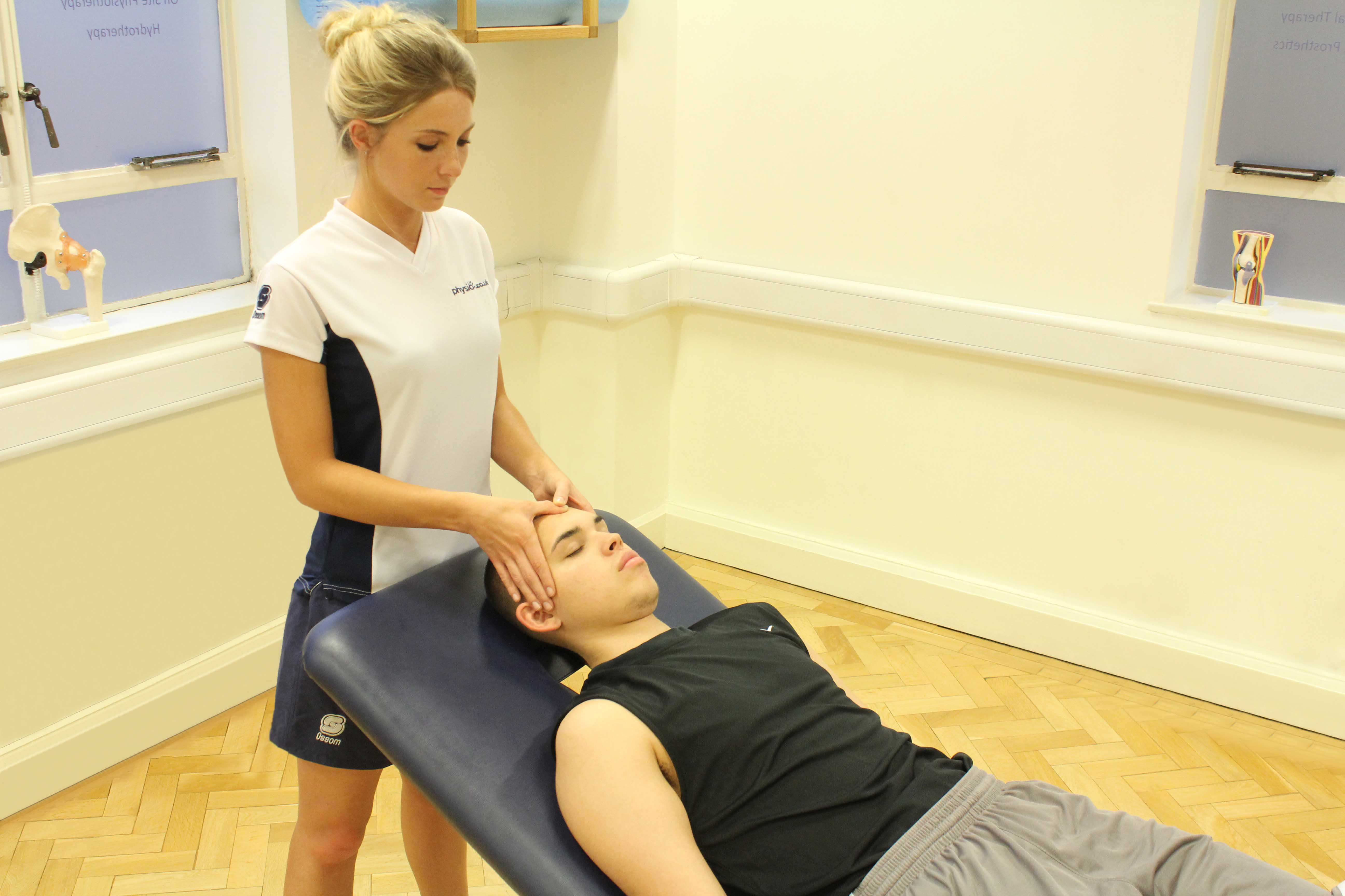 Soft tissue massage of head and face to releive stiffness and stimulate neurological repair