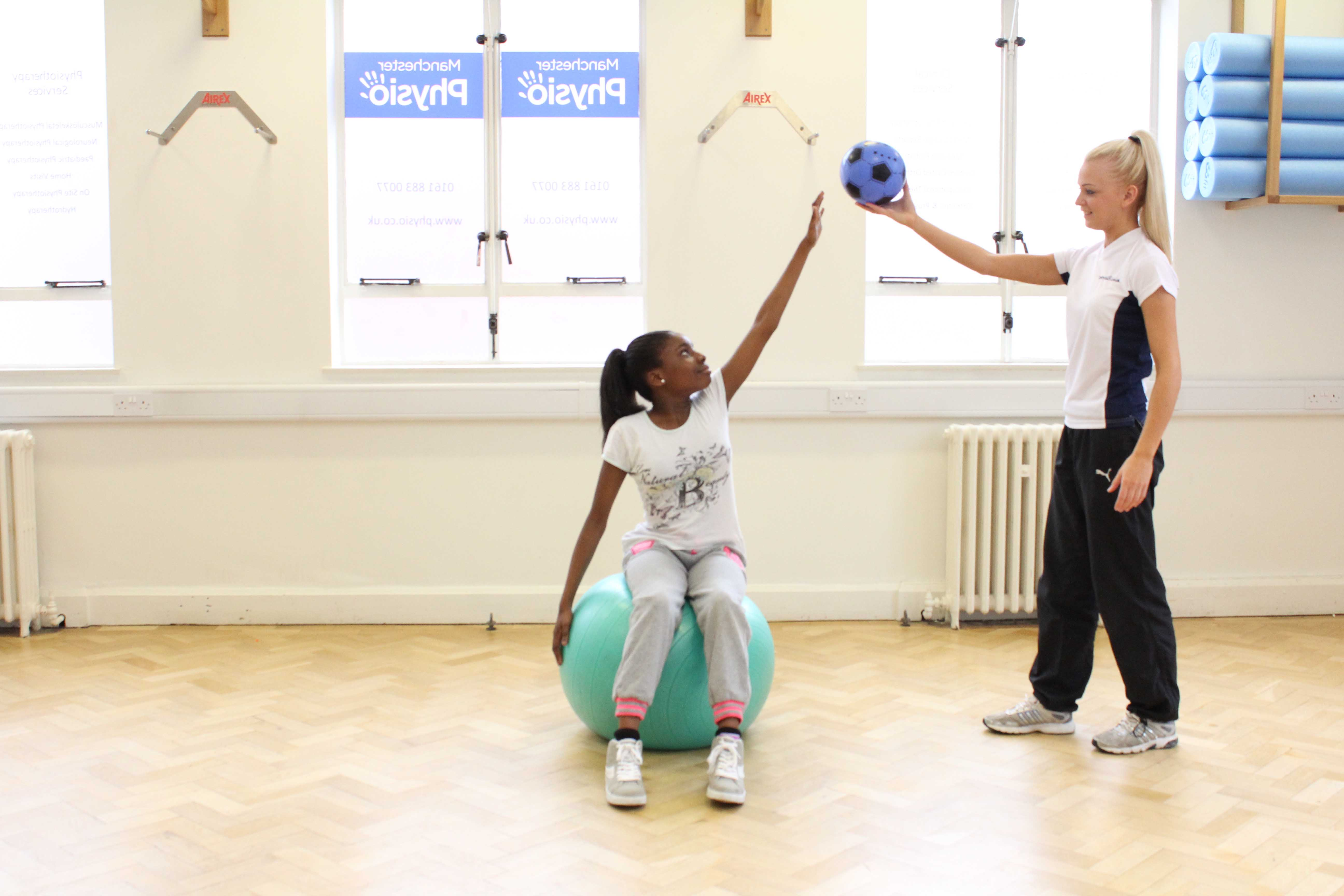 Rehabilitation through play, incorporating dynamic strength and stretching exercises.