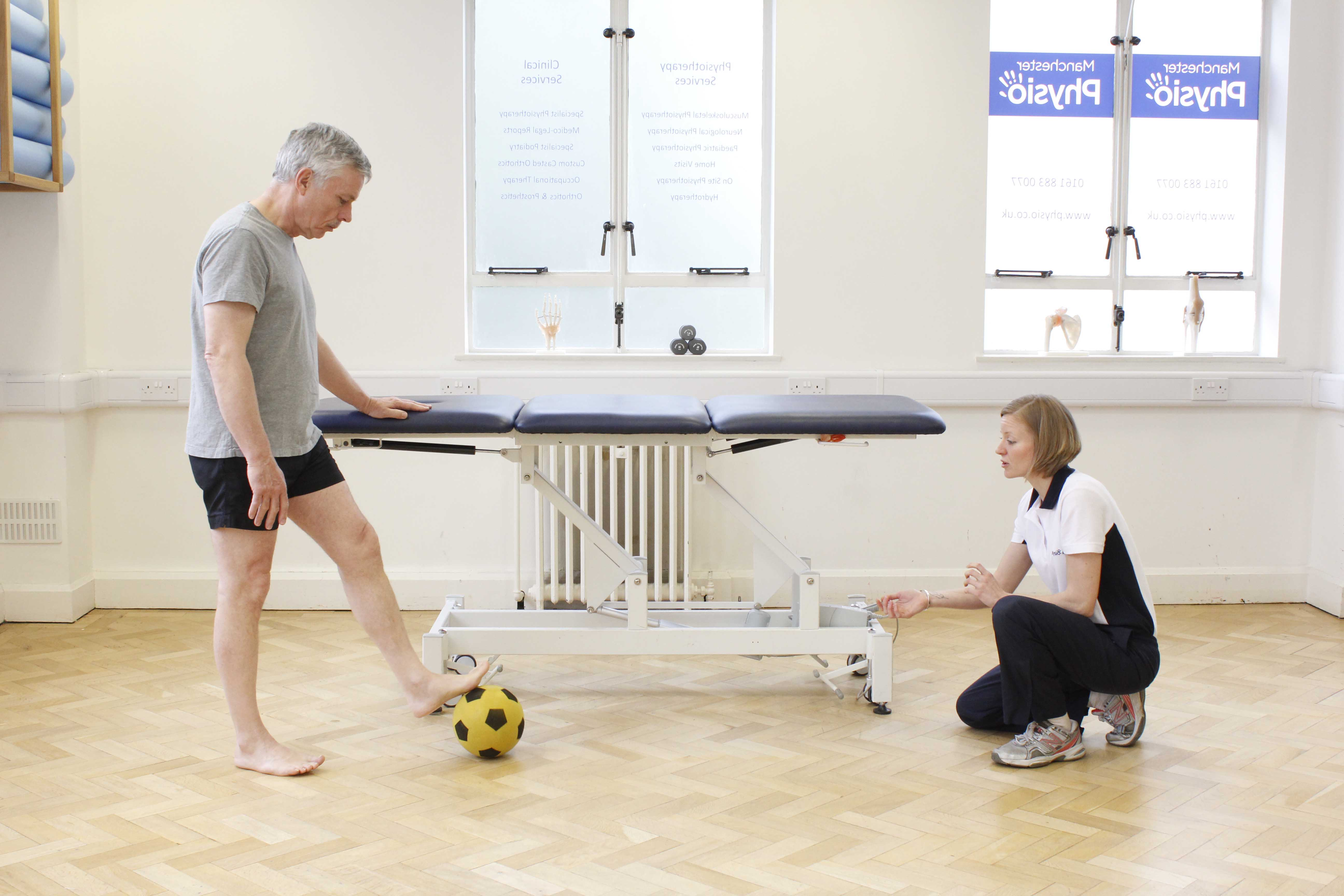 Neurological physiotherapist supervising gross motor skill co-ordination exercises