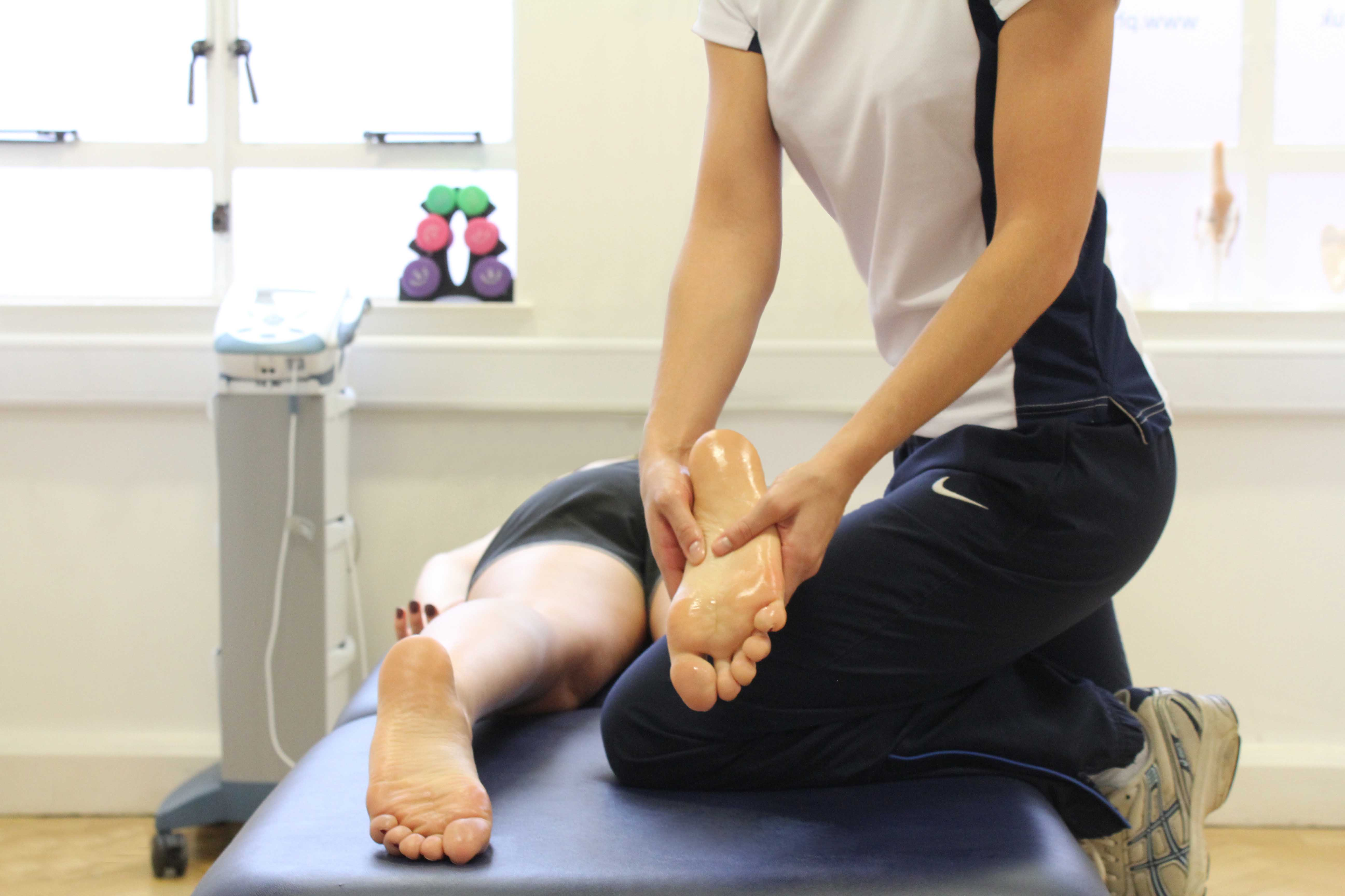 Therapist massage of planta fascia, bunions and toes