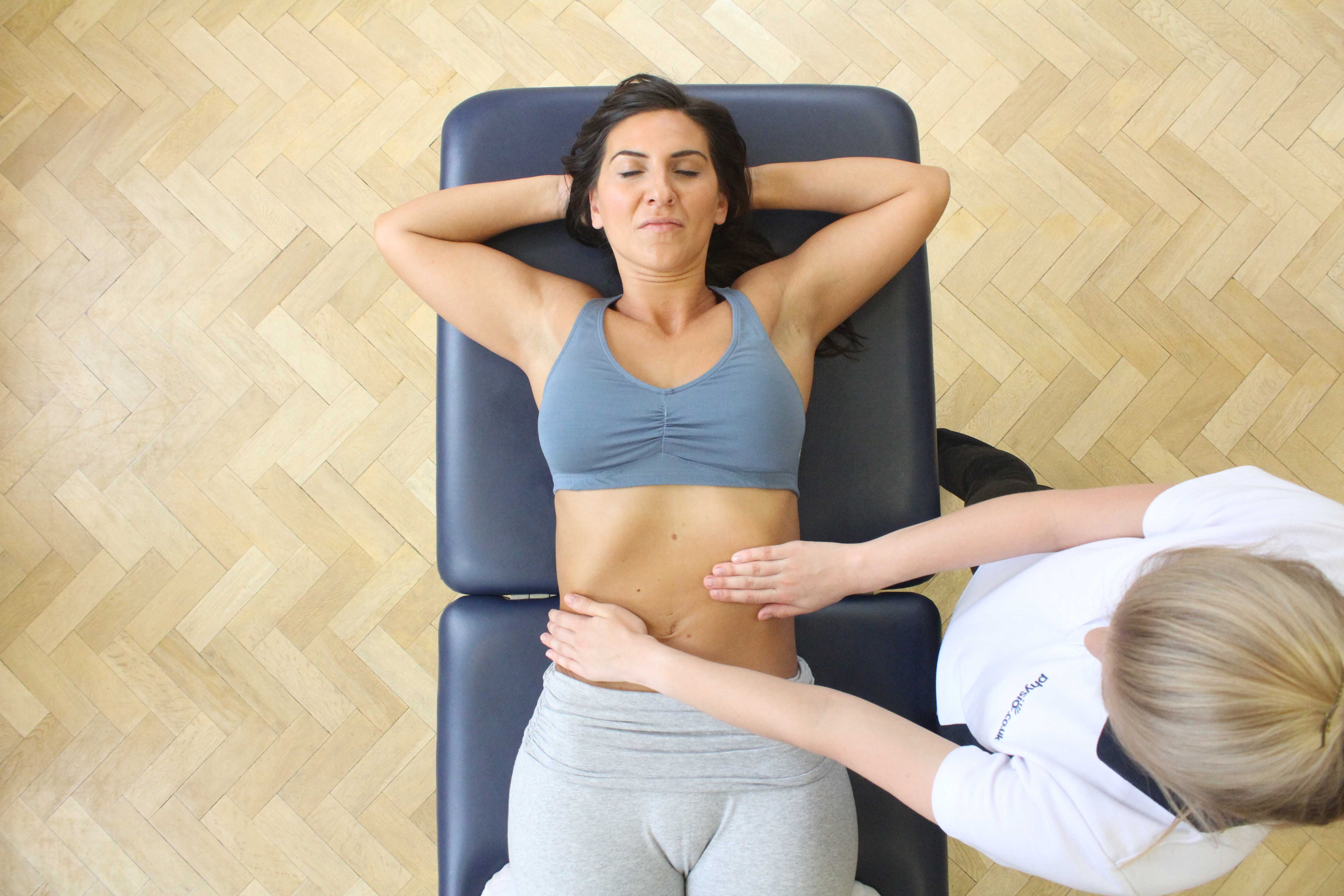 Soft tissue massage of the abdominal muscles by experienced MSK therapist