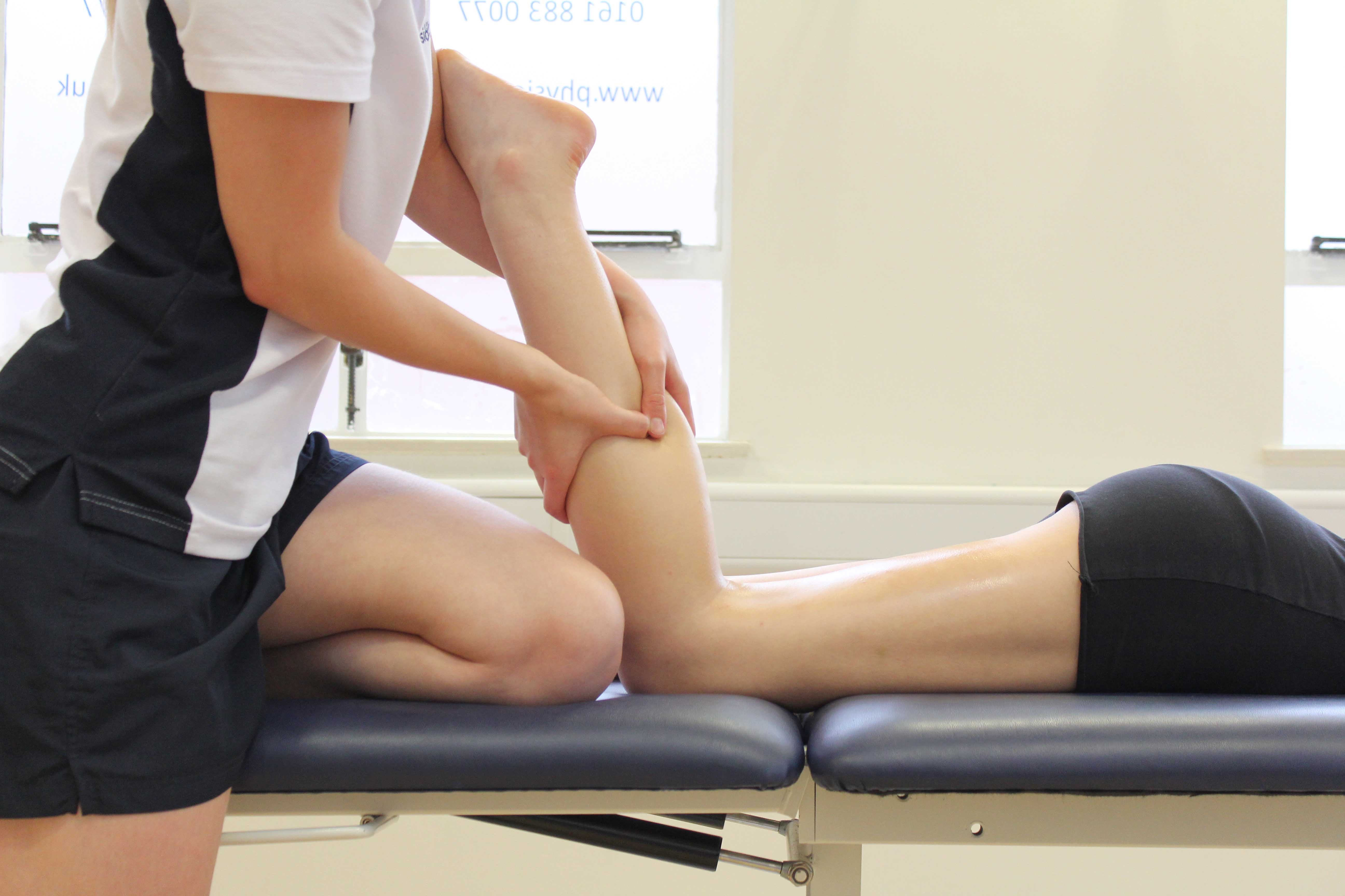 Trigger point massage applied to gastrocnemius muscle by specilaist therapist