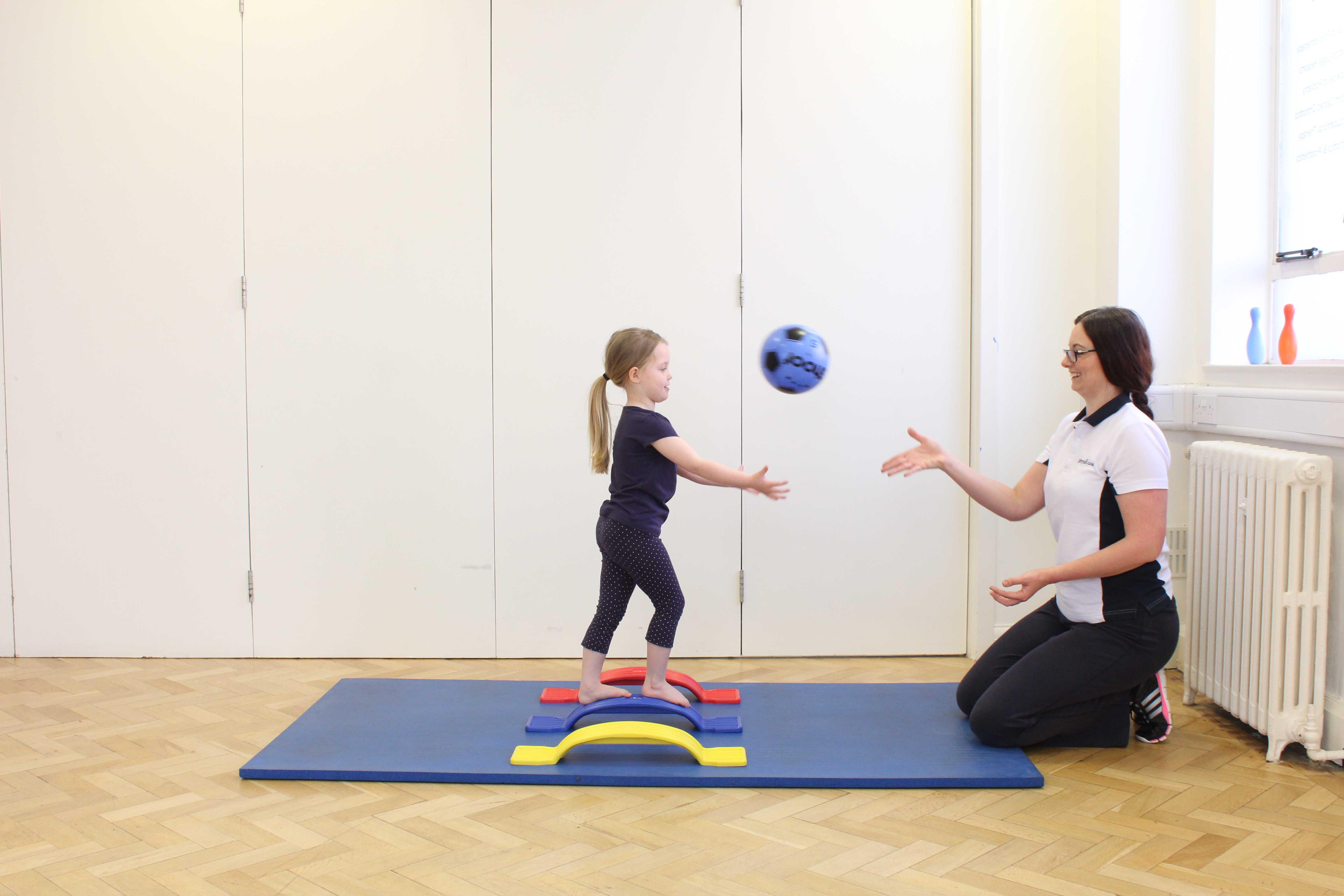 Balance and co-ordination rehabilitation exercises assisted by a paediatric physiotherapist