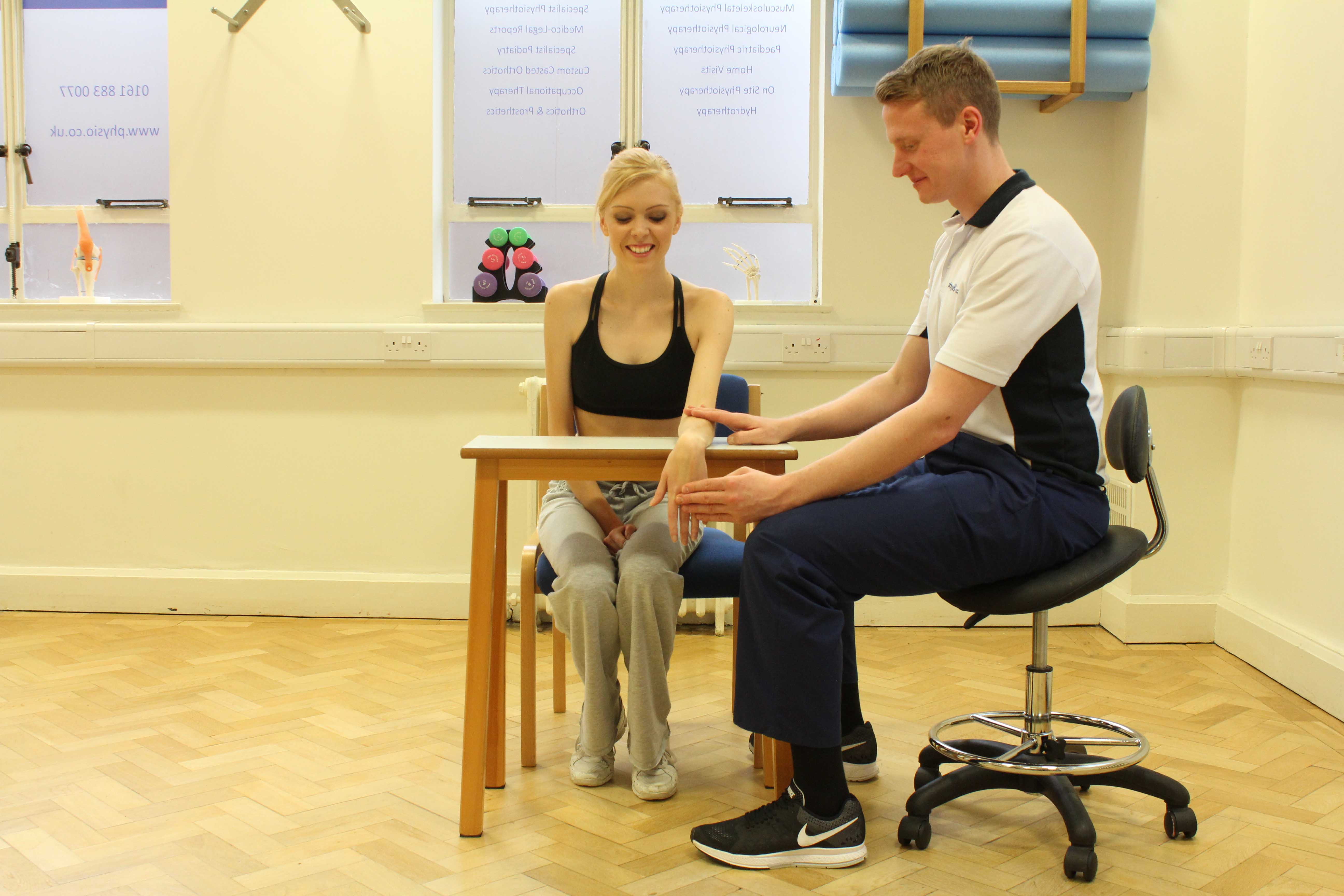 Our physiotherpaist assesing his patient for signs positive signs of carpal tunnel.