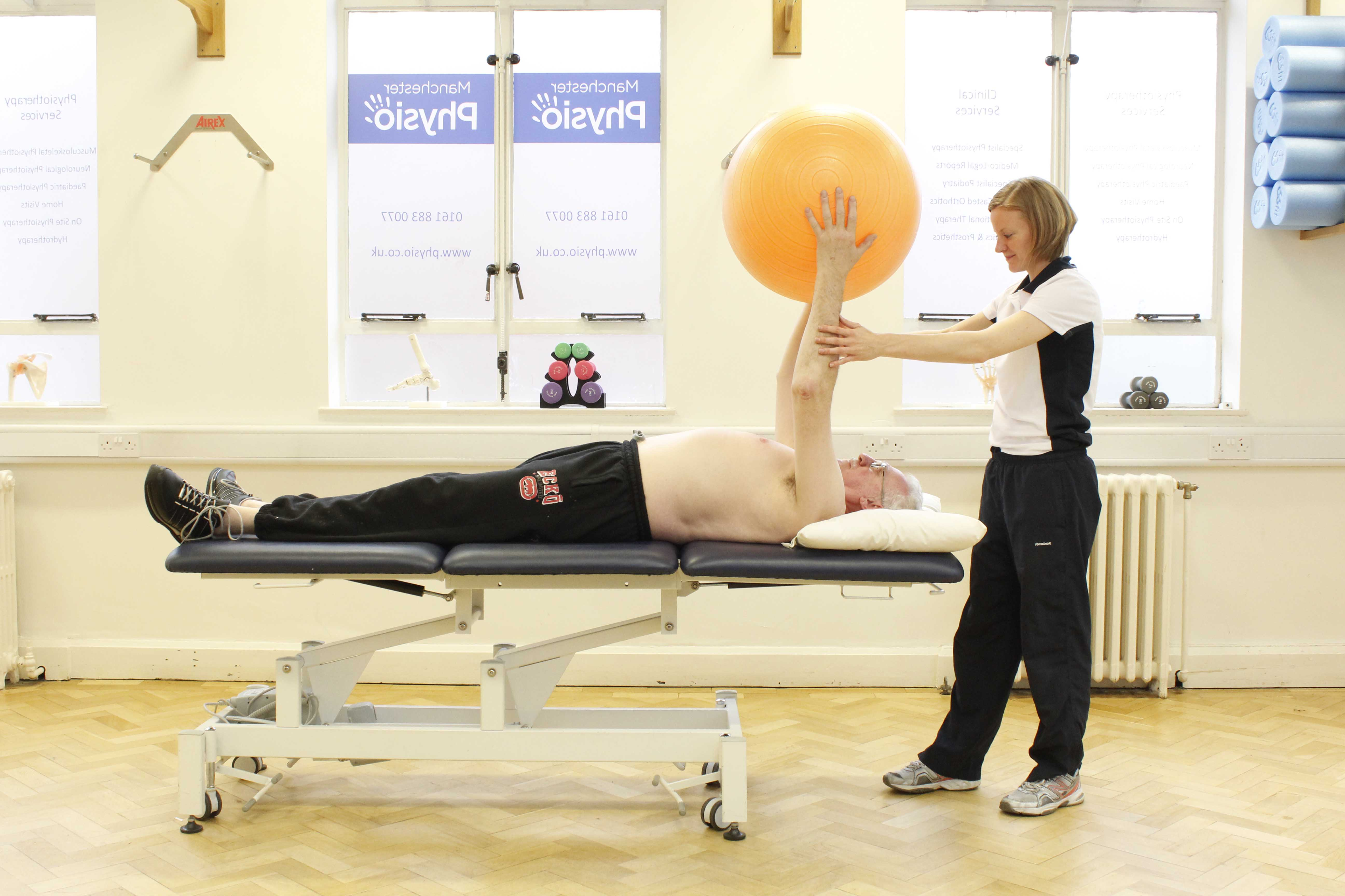 Upper limb mobility exercises using a gym ball assisted by a physiotherapist