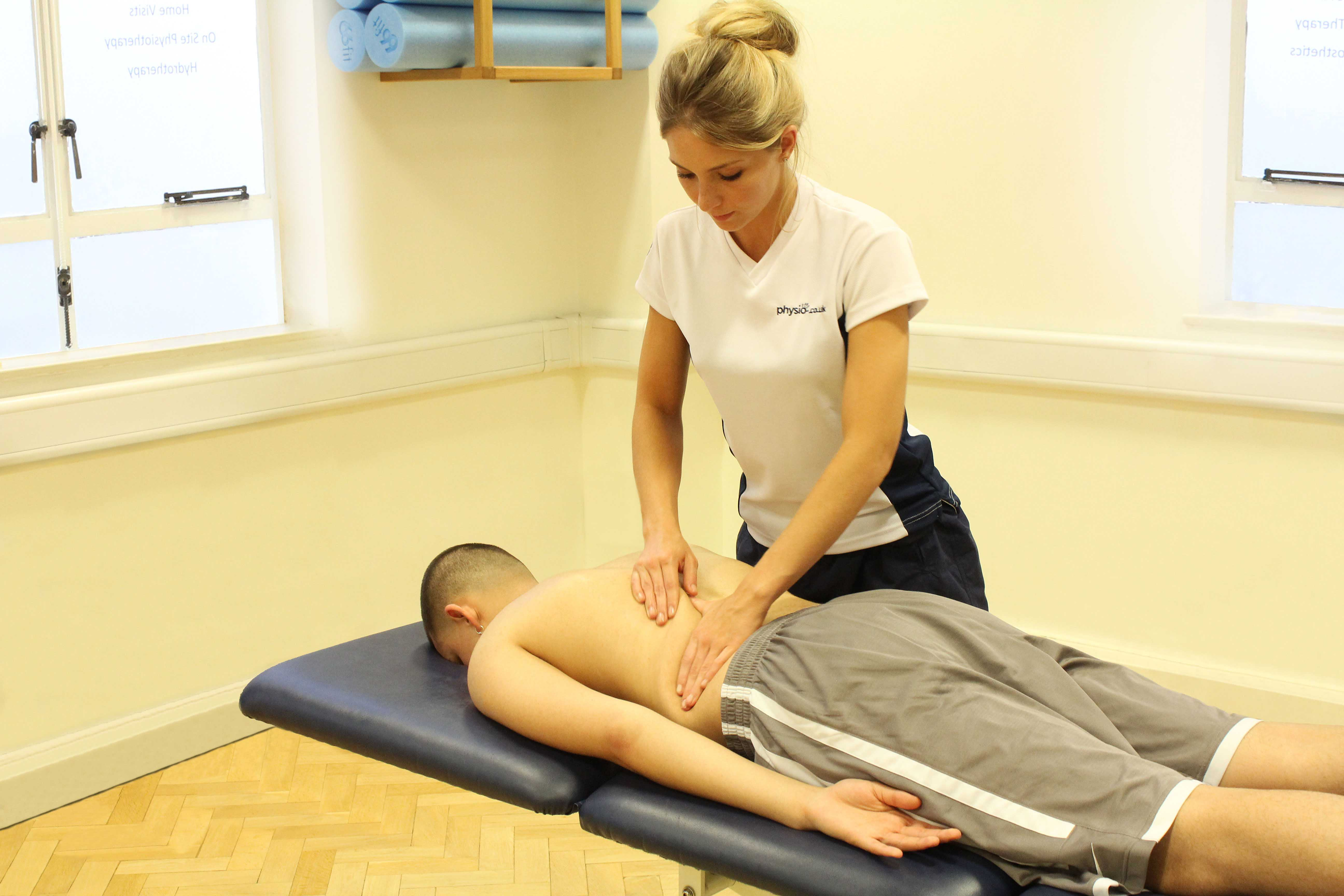 Soft tissue massage of the upper arms and shoulders following exercise to reduce muscle soreness