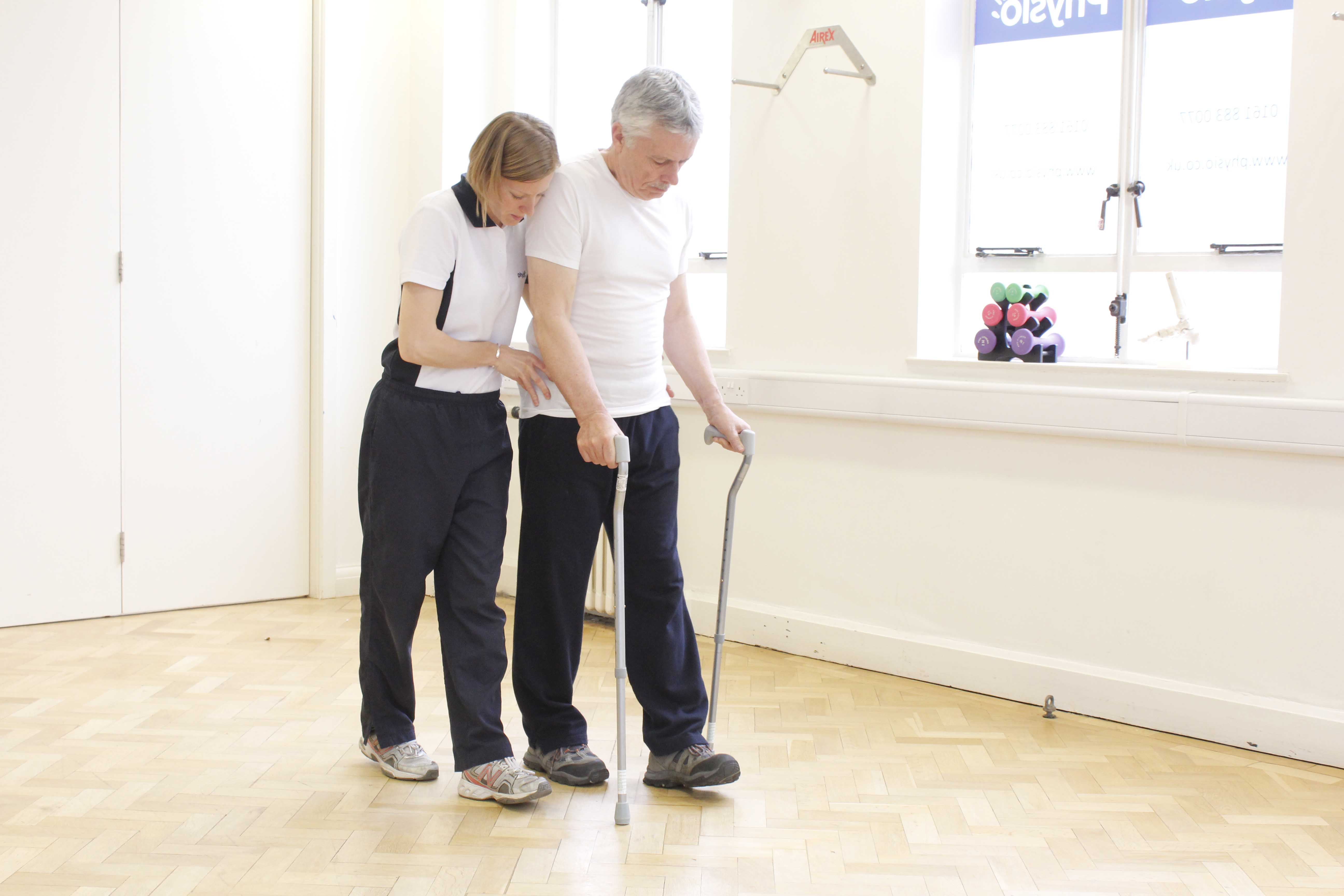 Mobilisation exercises using walking sticks supervised by a neuro physiotherapist