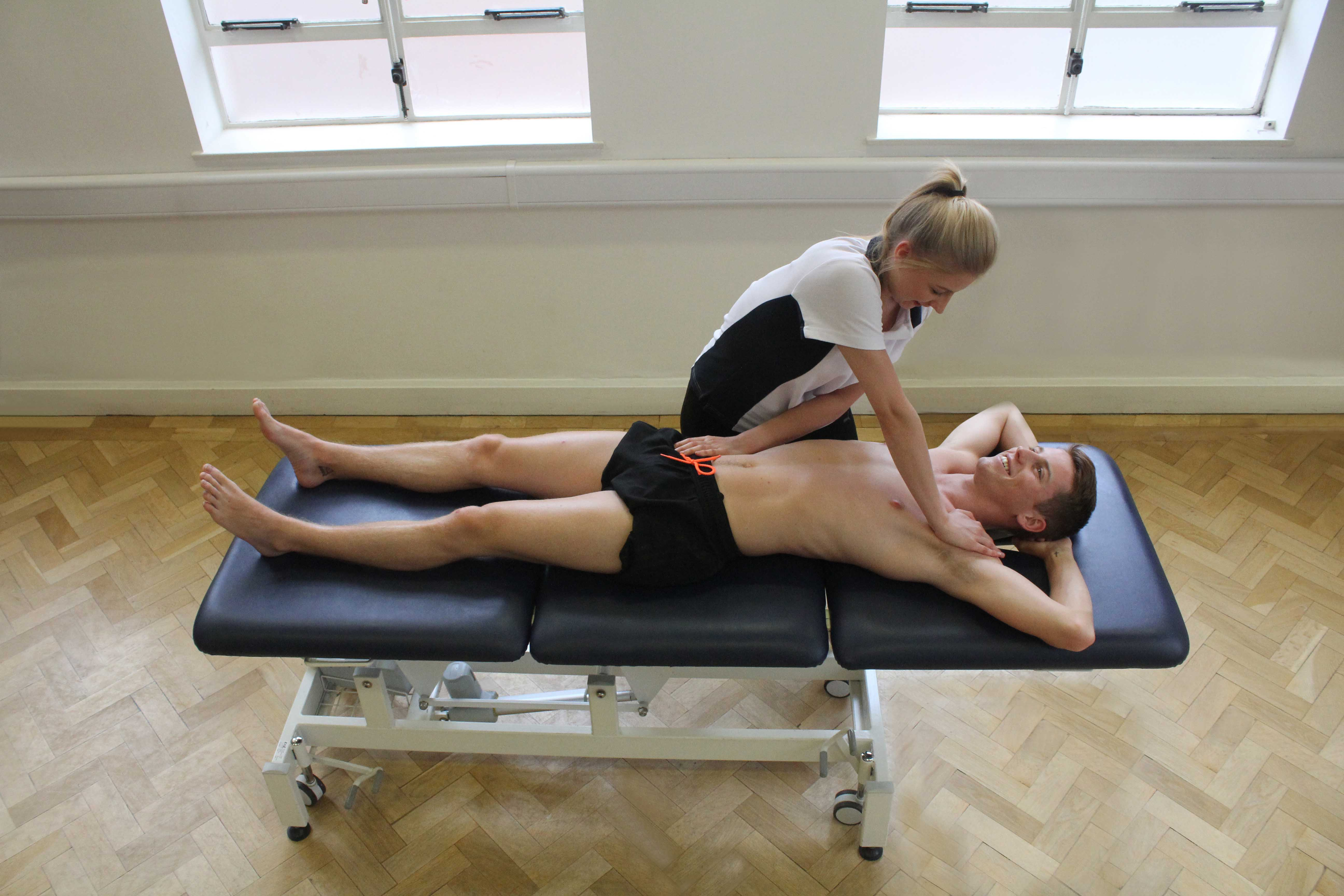Soft tissue massage and stretching of pectoralis major muscle