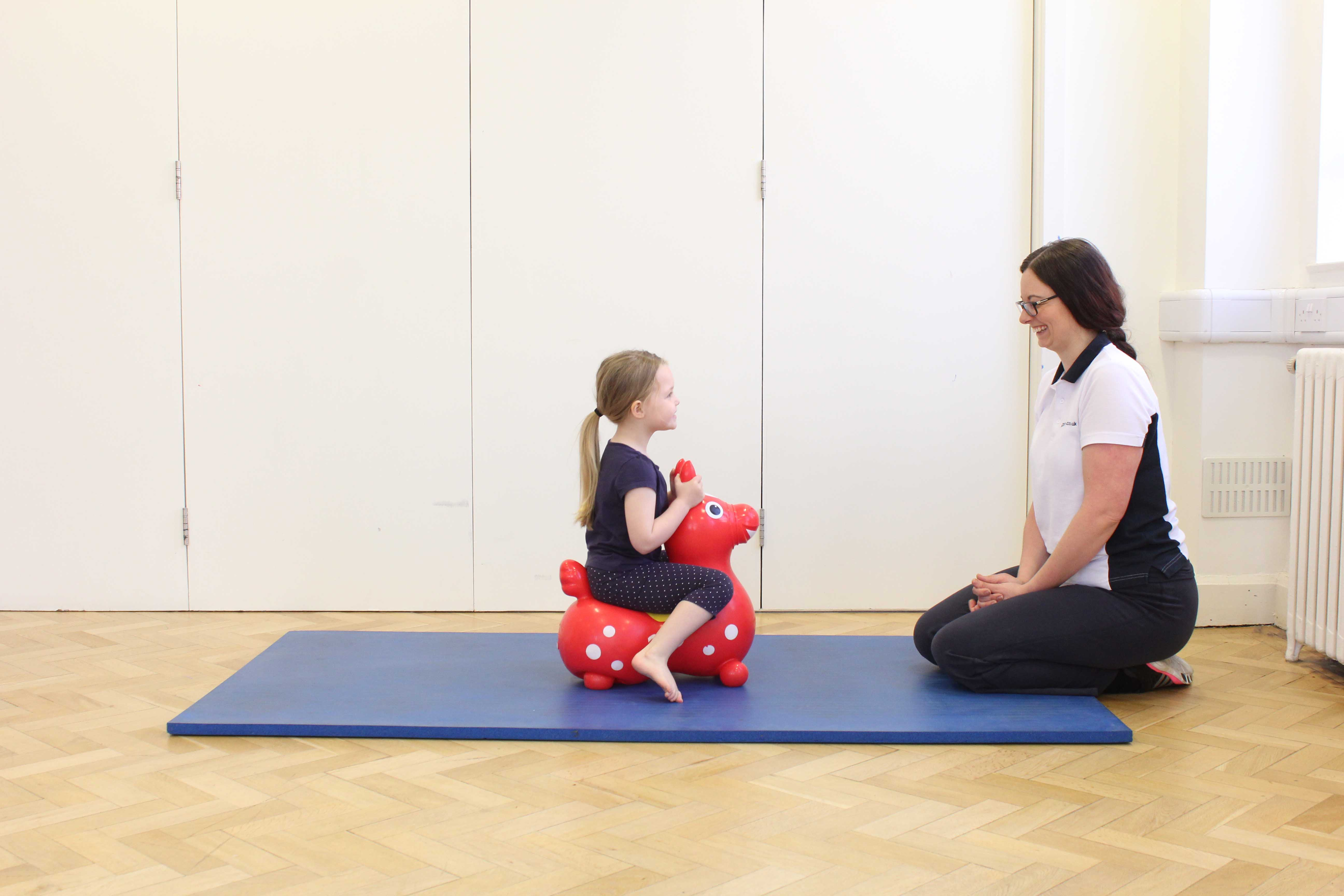 Paediatric physiotherapist promoting functional ability through play activities