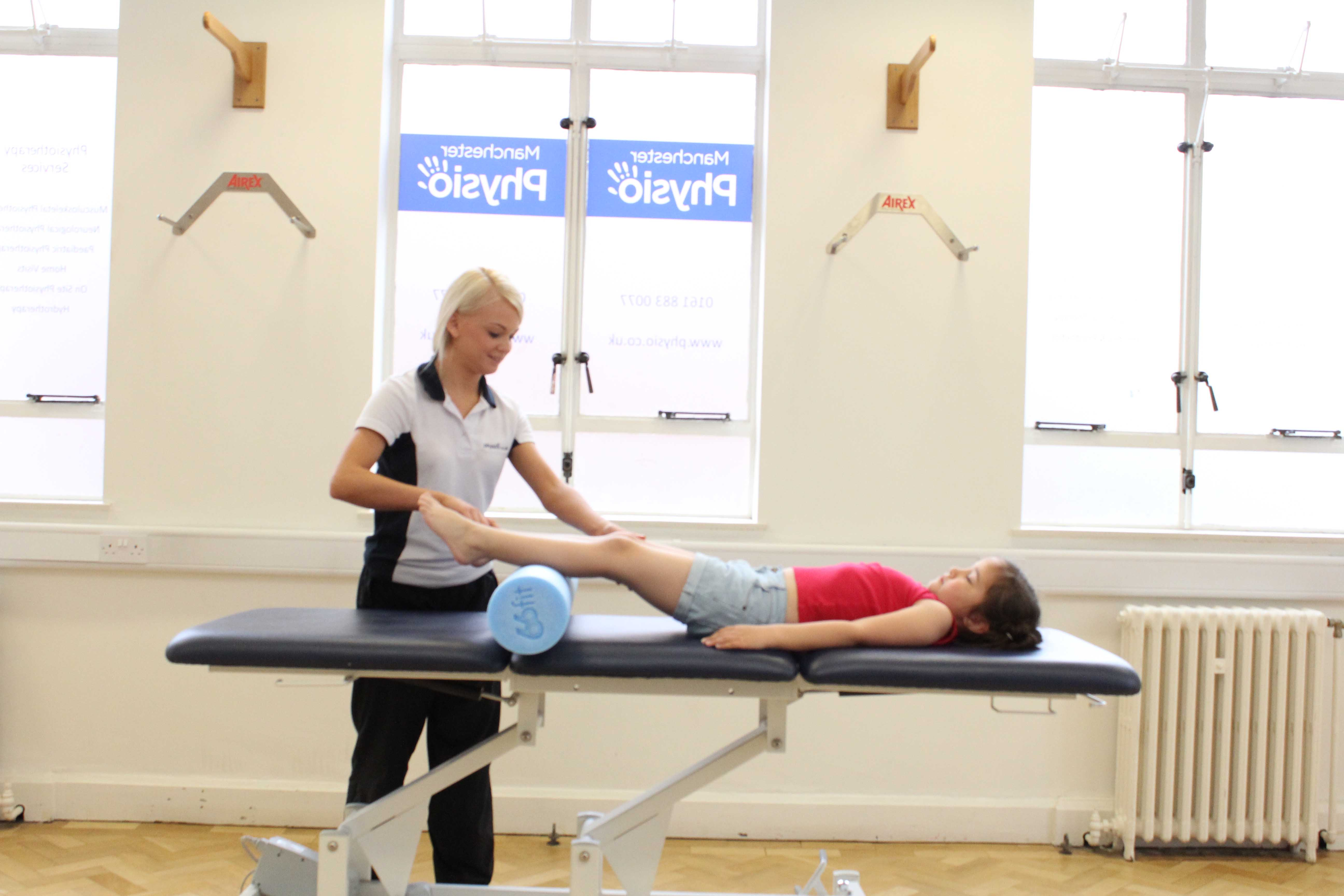 Mobilisations and stretches of the hip, knee and ankle by a paediatric physiotherapist
