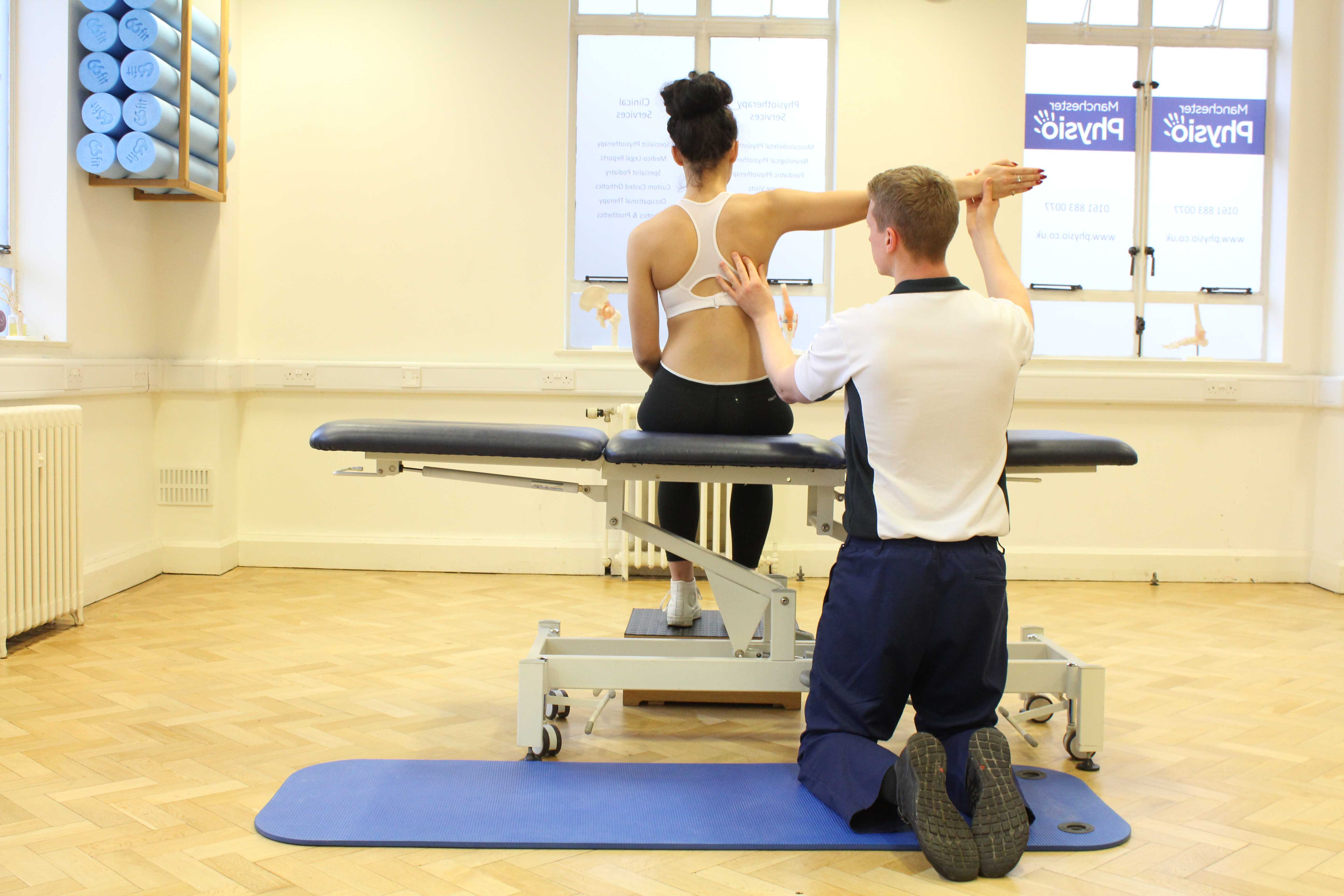 Experienced physiotherapist assessing underlying cause of persistant shoulder pain