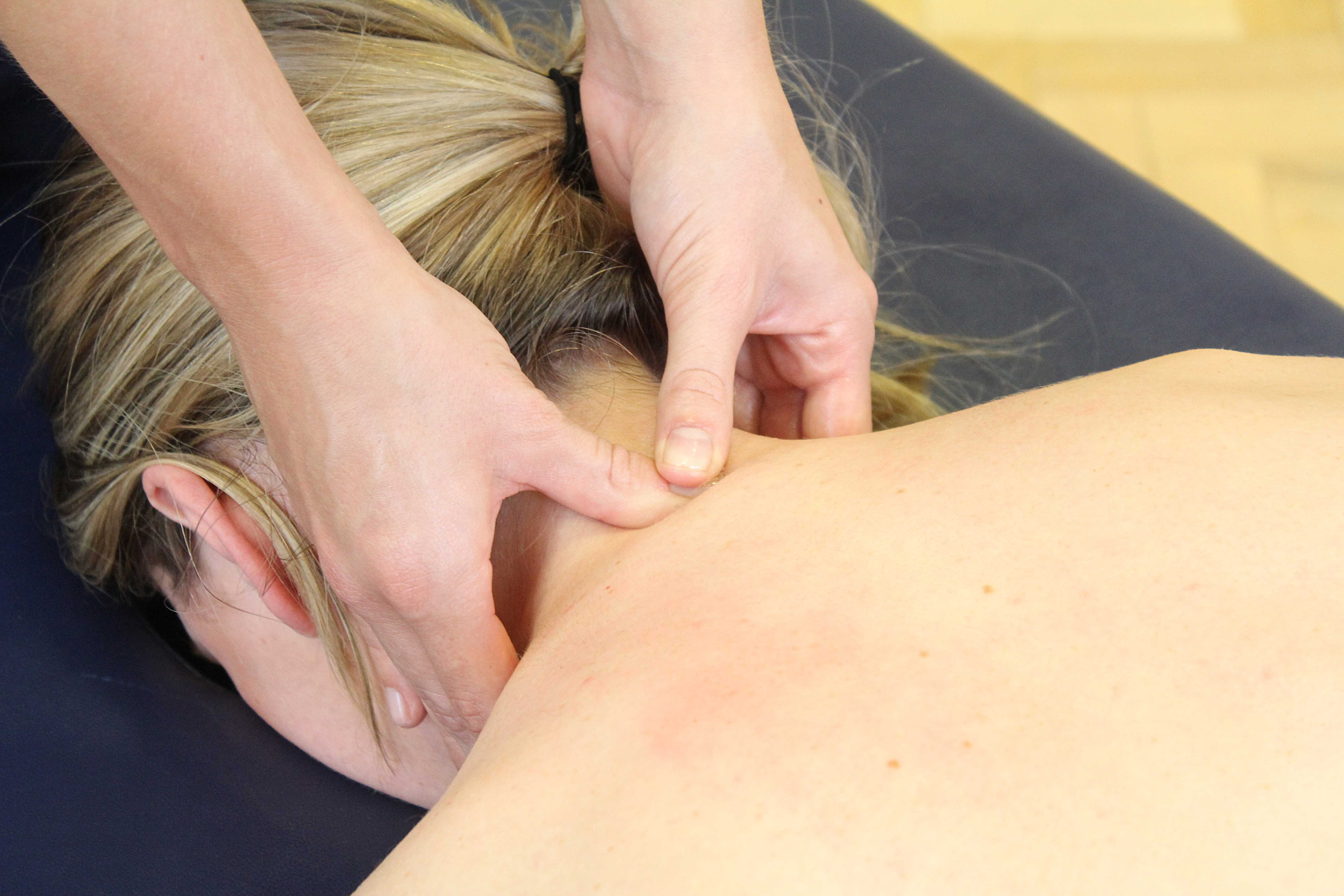 Massage of cervical spine and trapezius muscles to reduce chonic pain symptoms