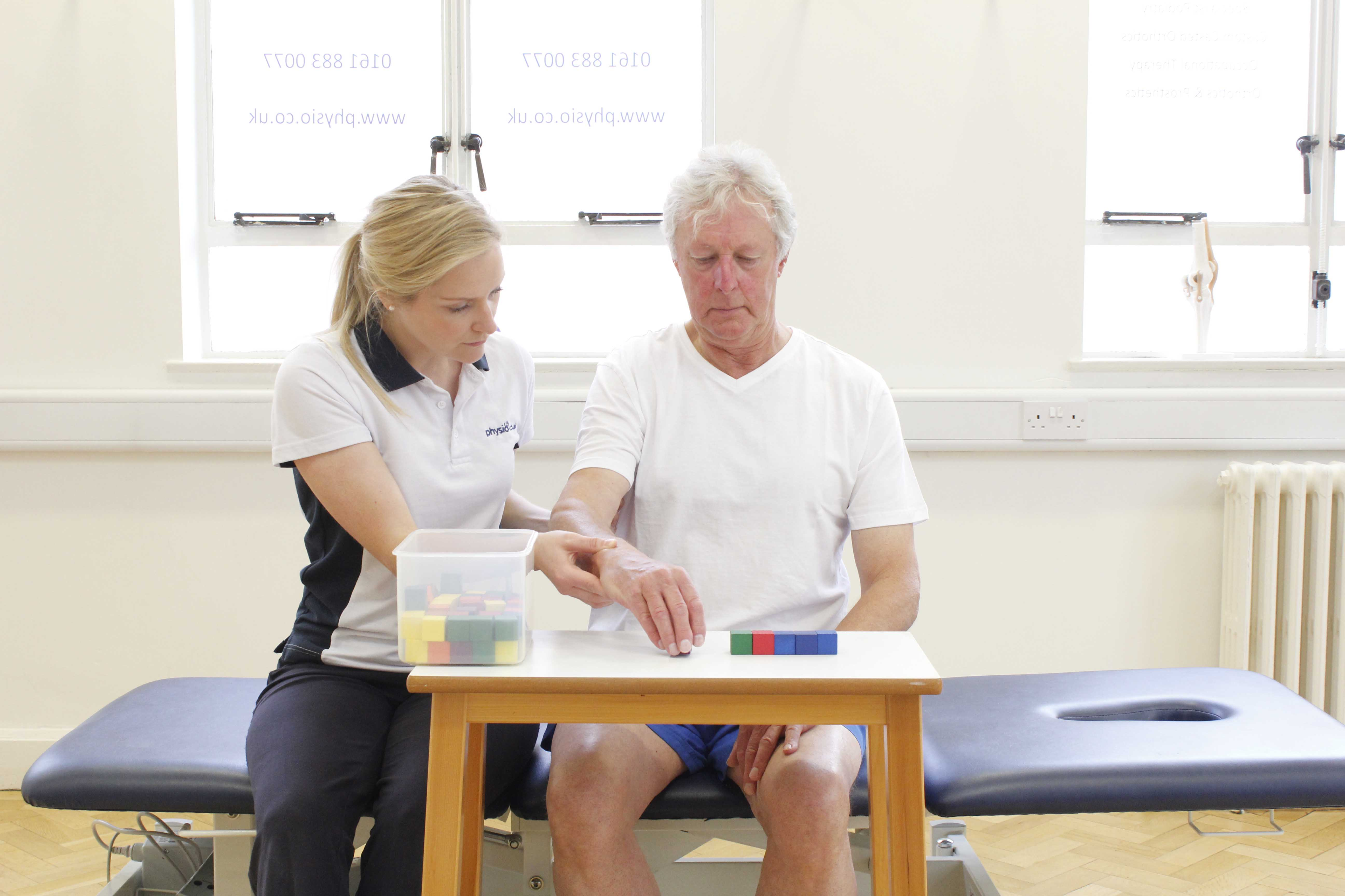 Specilaist neurological physiotherapist supervising fone motor skill and cognition exercises