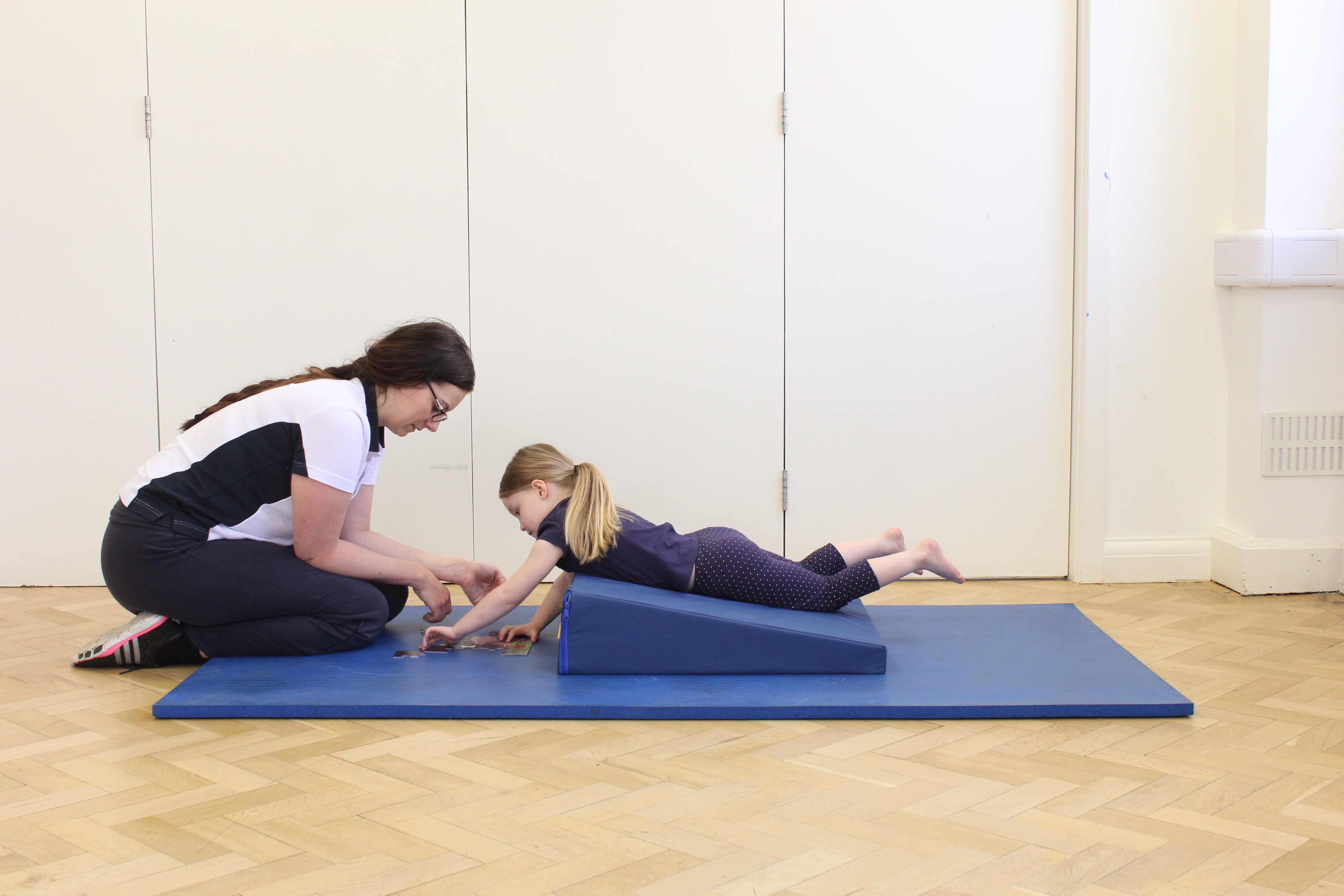 neurological physiotherapist developing communication skills through play activites