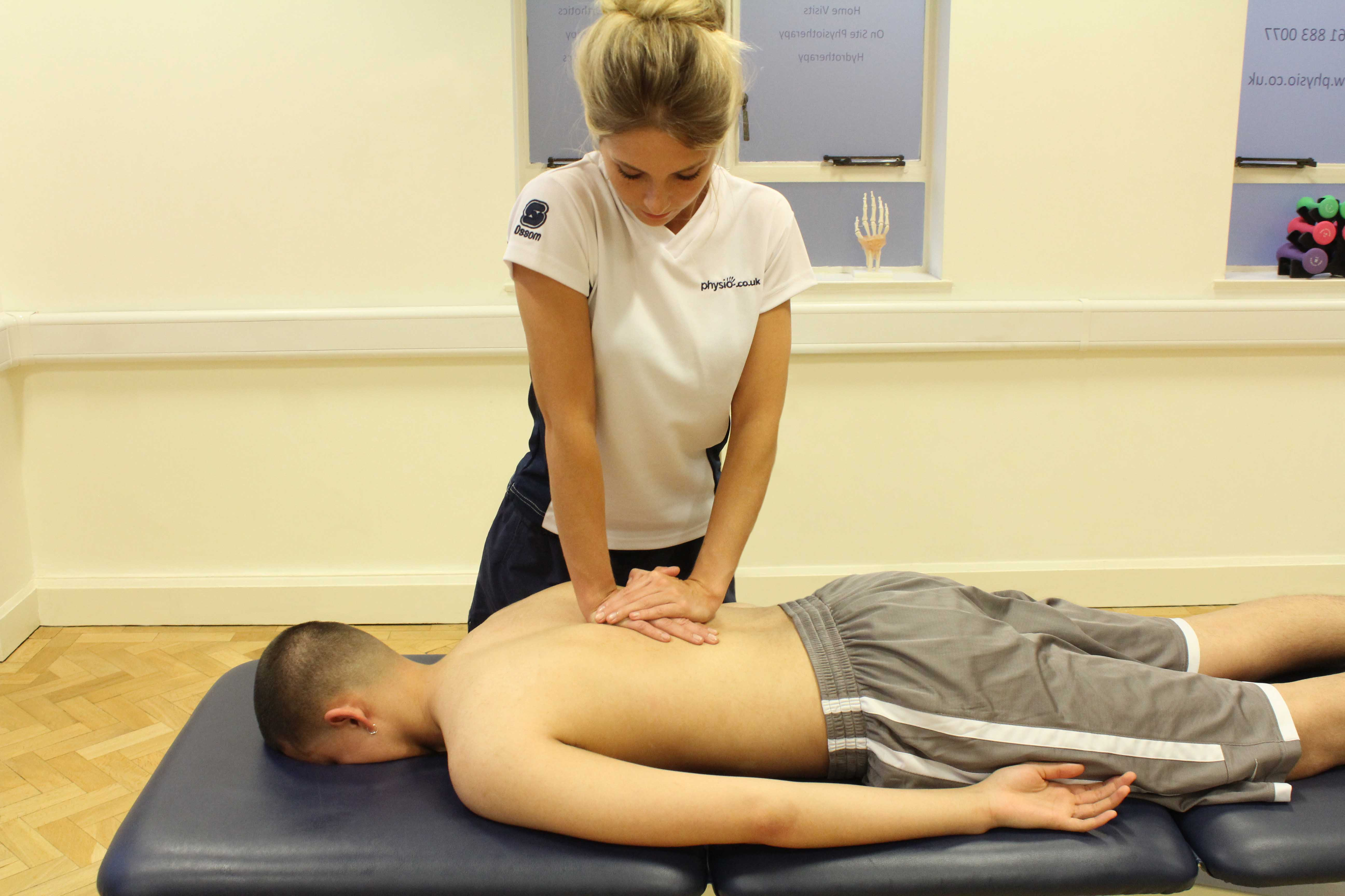compression massage technique applied to thoracic spine