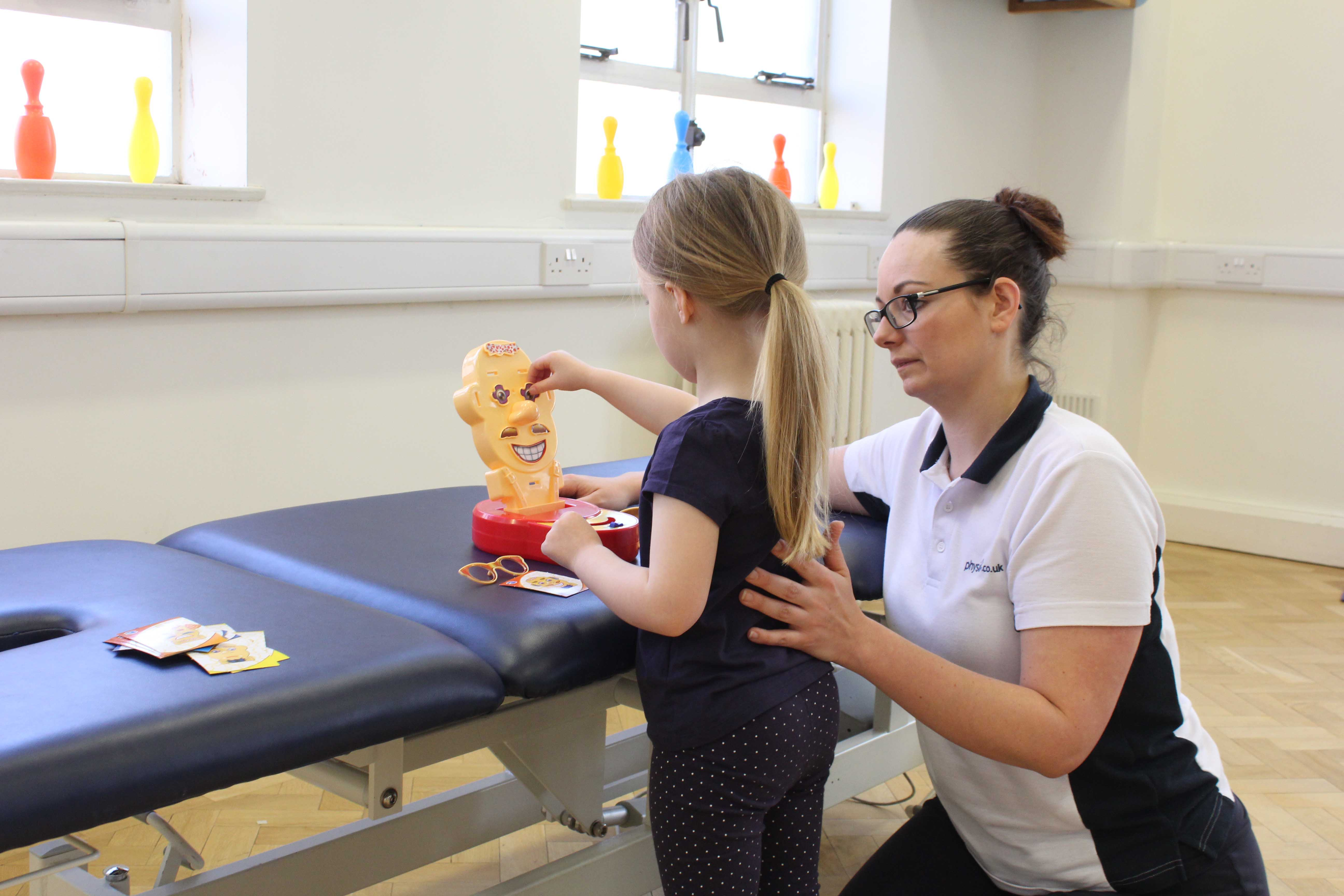 Functional fine motor skill exercises supervised by a neurological physiotherapist