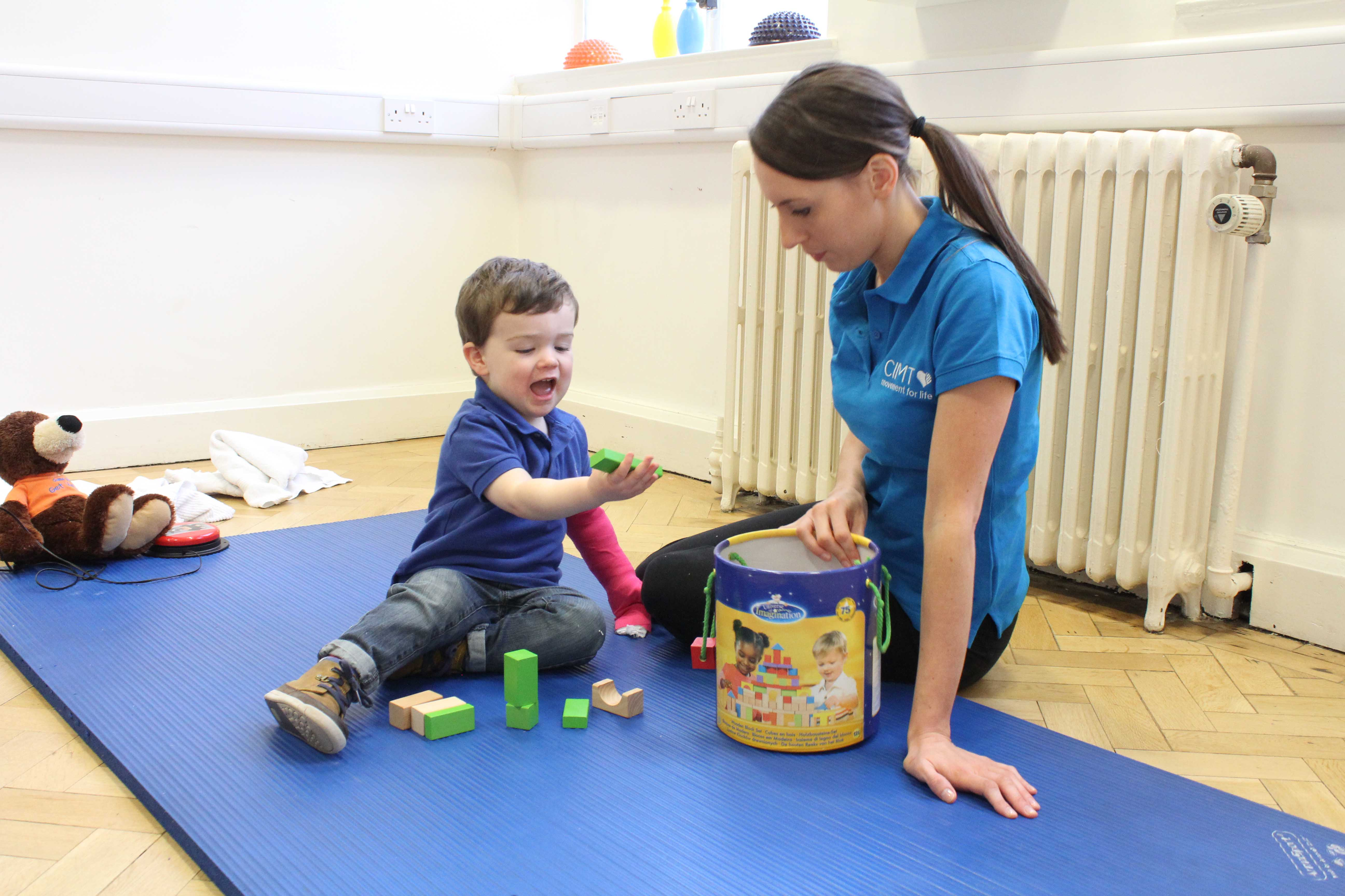 Equalising the development of fine motor skills by constraining the dominant limb and engaging with structured play