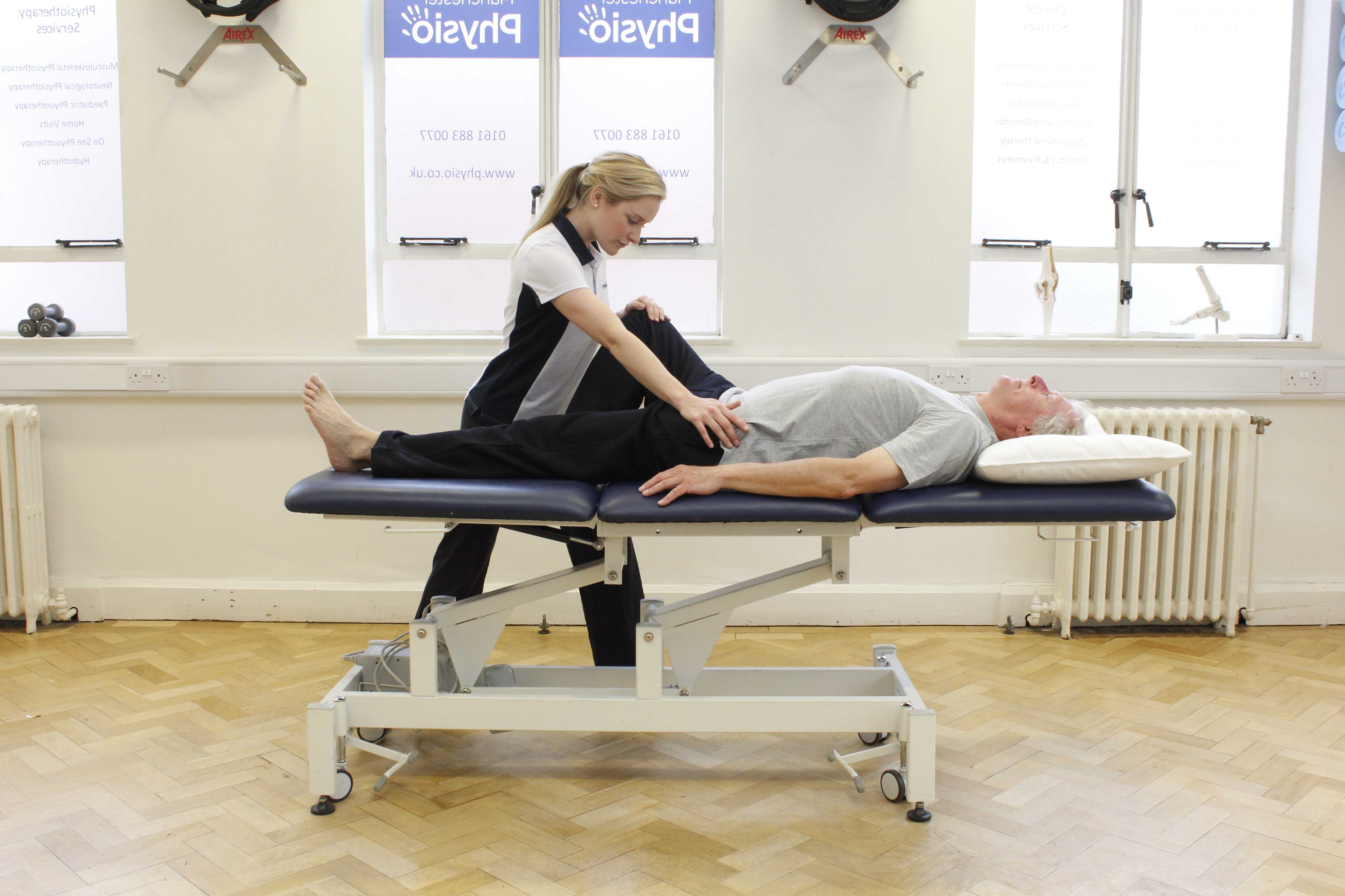 Pelvis and hip abduction stretches assisted by specialist physiotherapist