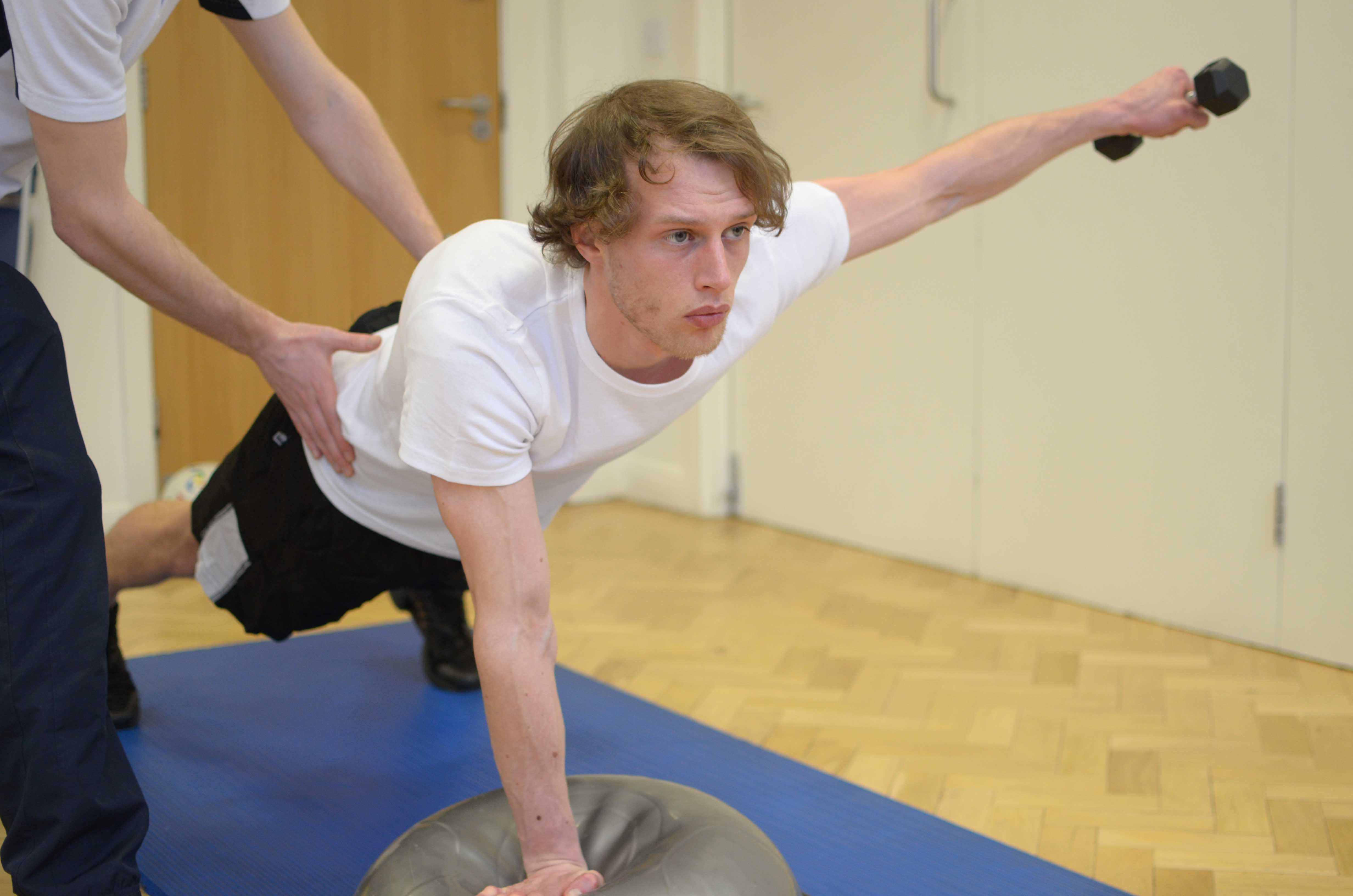Dynamic balance and co-ordination exercises assisted by an experienced Physiotherapist