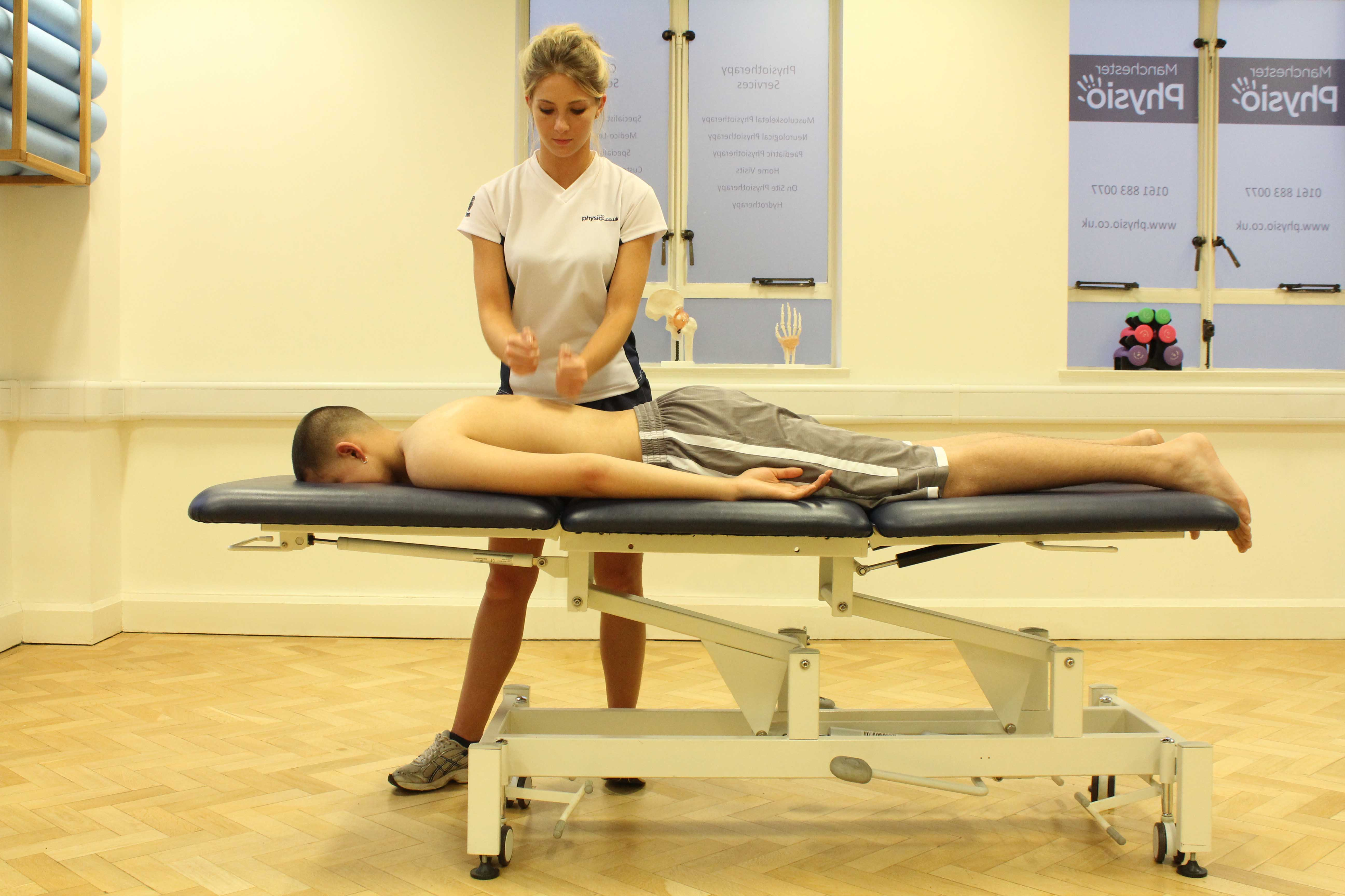 Percussion massage applied to the mid thoracic spine