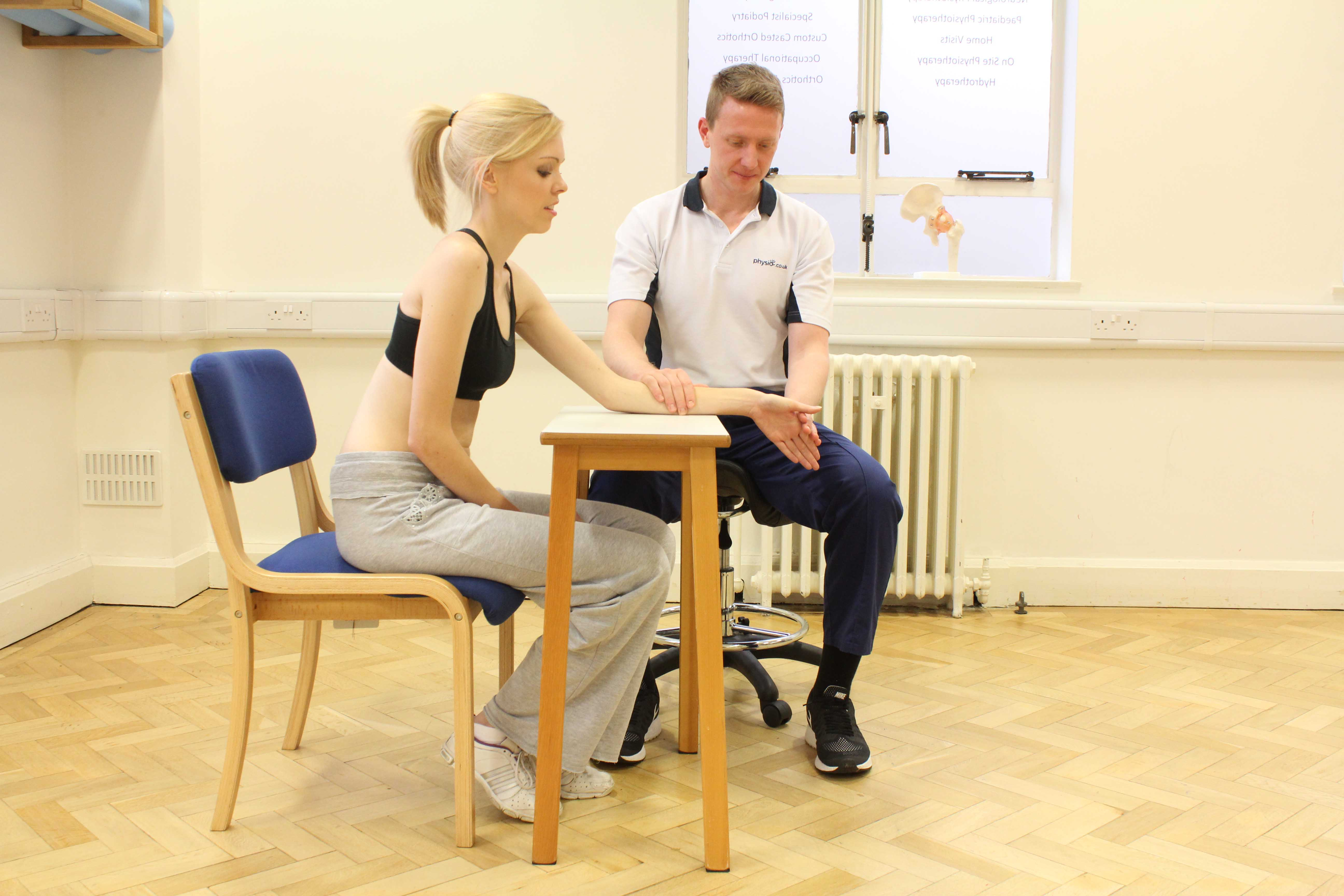 Phtsiotherapist assisted lateral deviation of the wrist stretches
