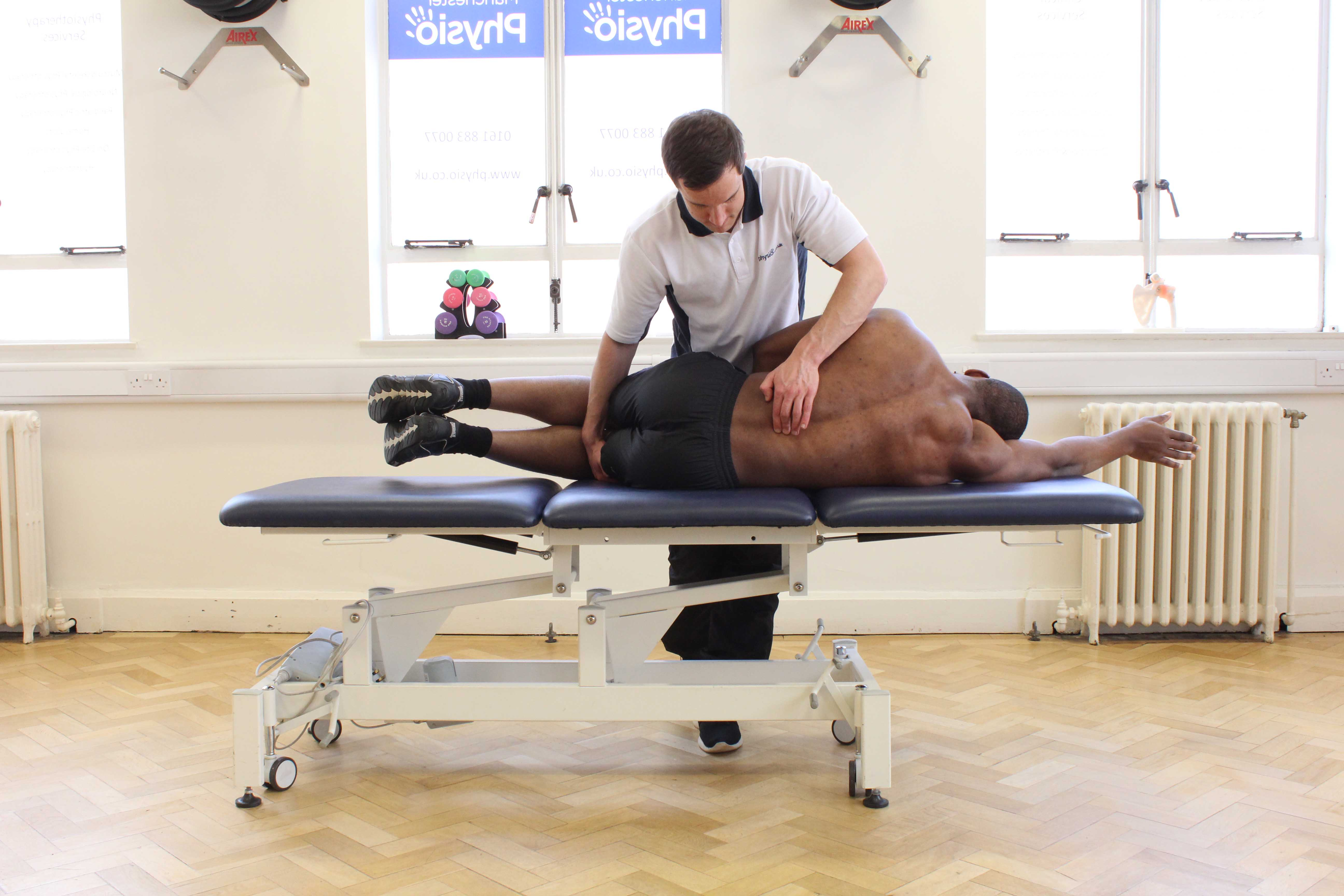 Stripping massage of the trapezius muscle by MSK therapist