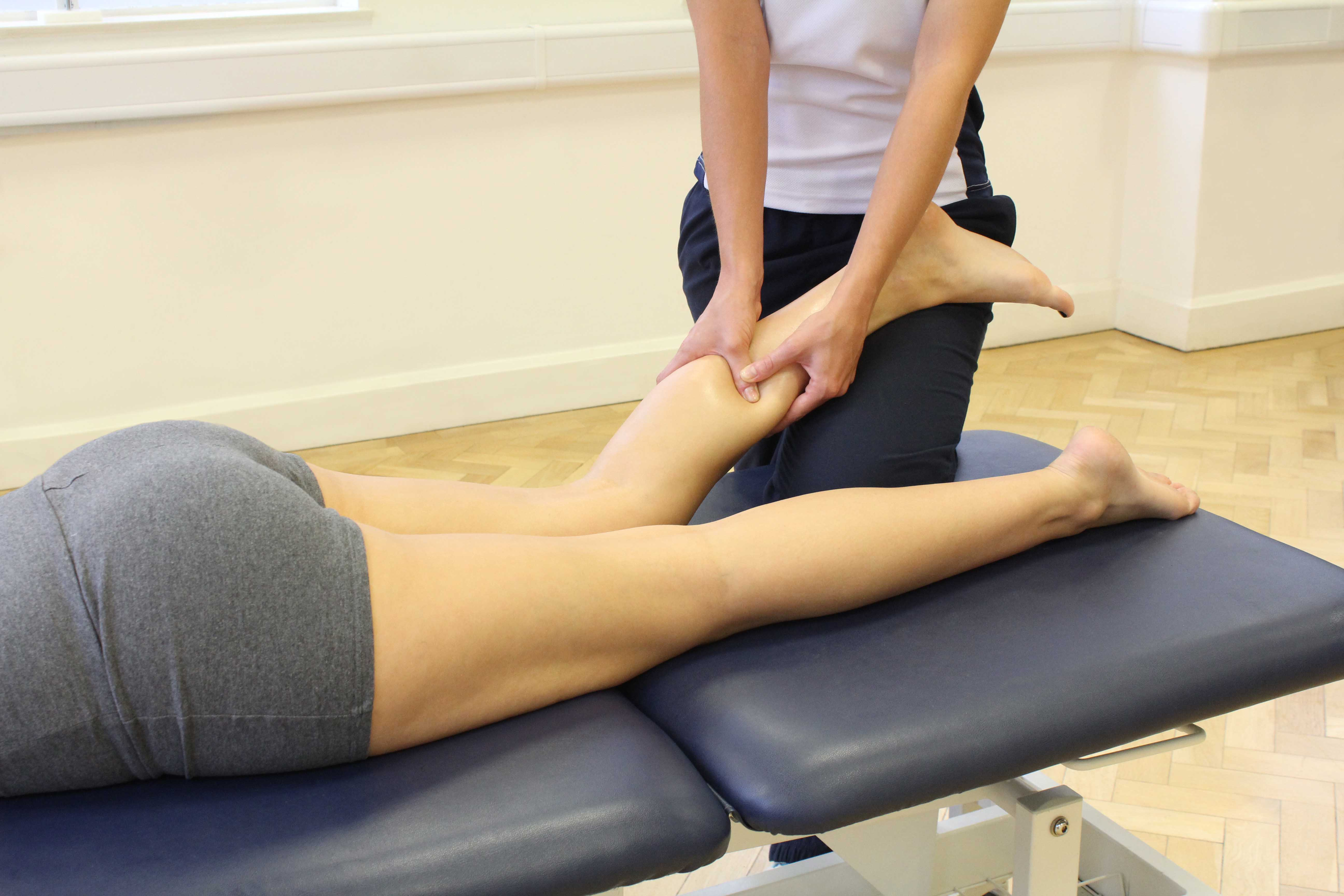 Deep tissue massage on soleus muscle