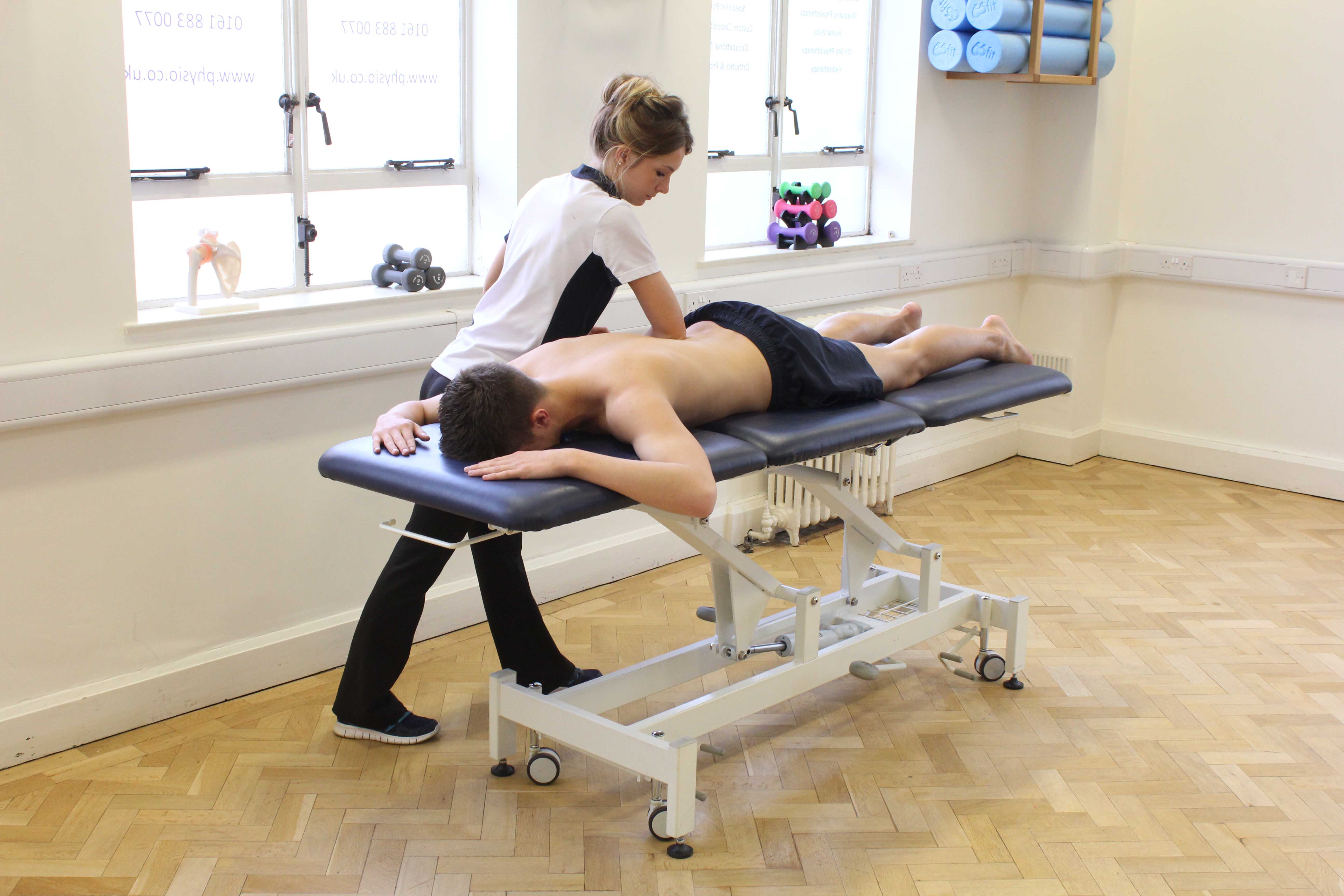 Deep tissue massage of lower latissimus  and lumber region to address delayed onset muscle soreness