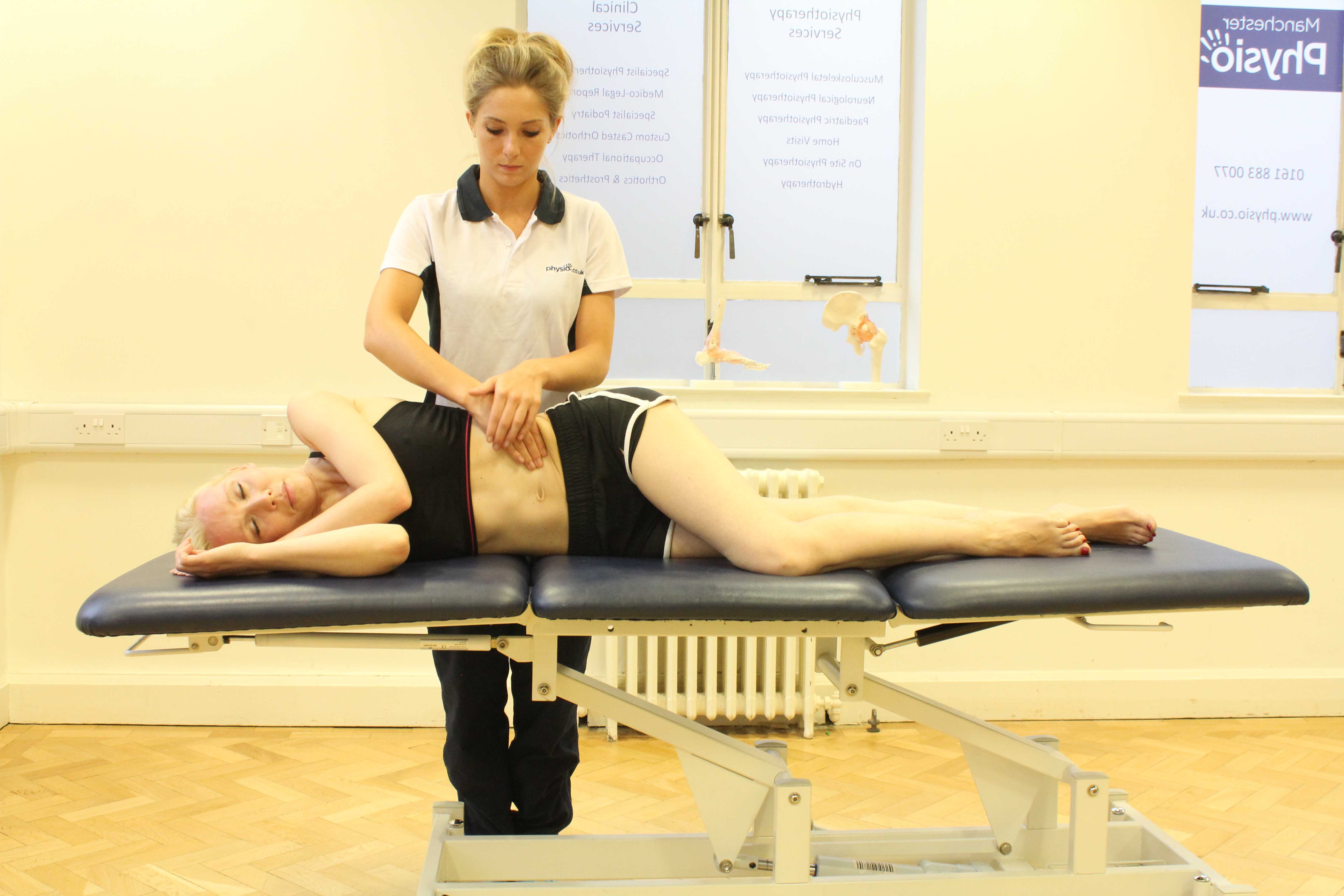 Soft tissue massage of the abdominal muscles by a specialist massage therapist