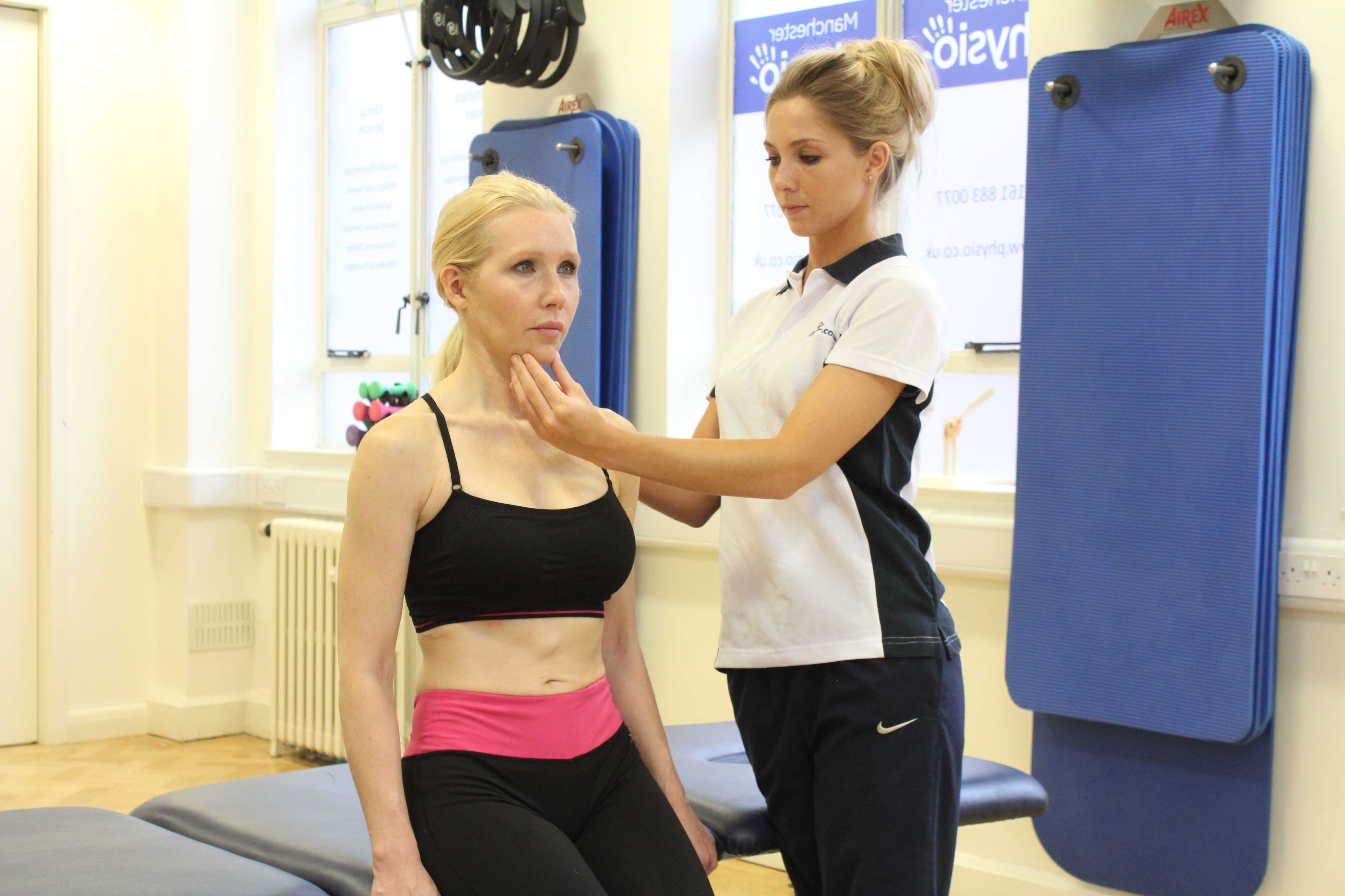 Postural realignment exercises for the neck assisted by specialist MSK therapist